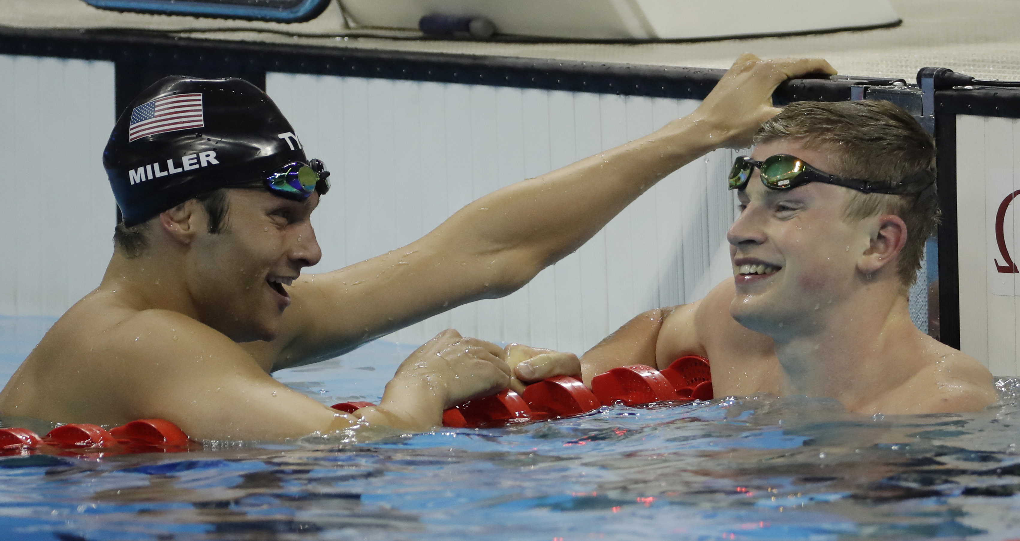 Britain's Adam Peaty, right, and United States' Cody Miller talk after a men's 100-meter breaststroke semifinal during the swimming competitions at the 2016 Summer Olympics, Saturday, Aug. 6, 2016, in Rio de Janeiro, Brazil. (AP Photo/Matt Slocum)