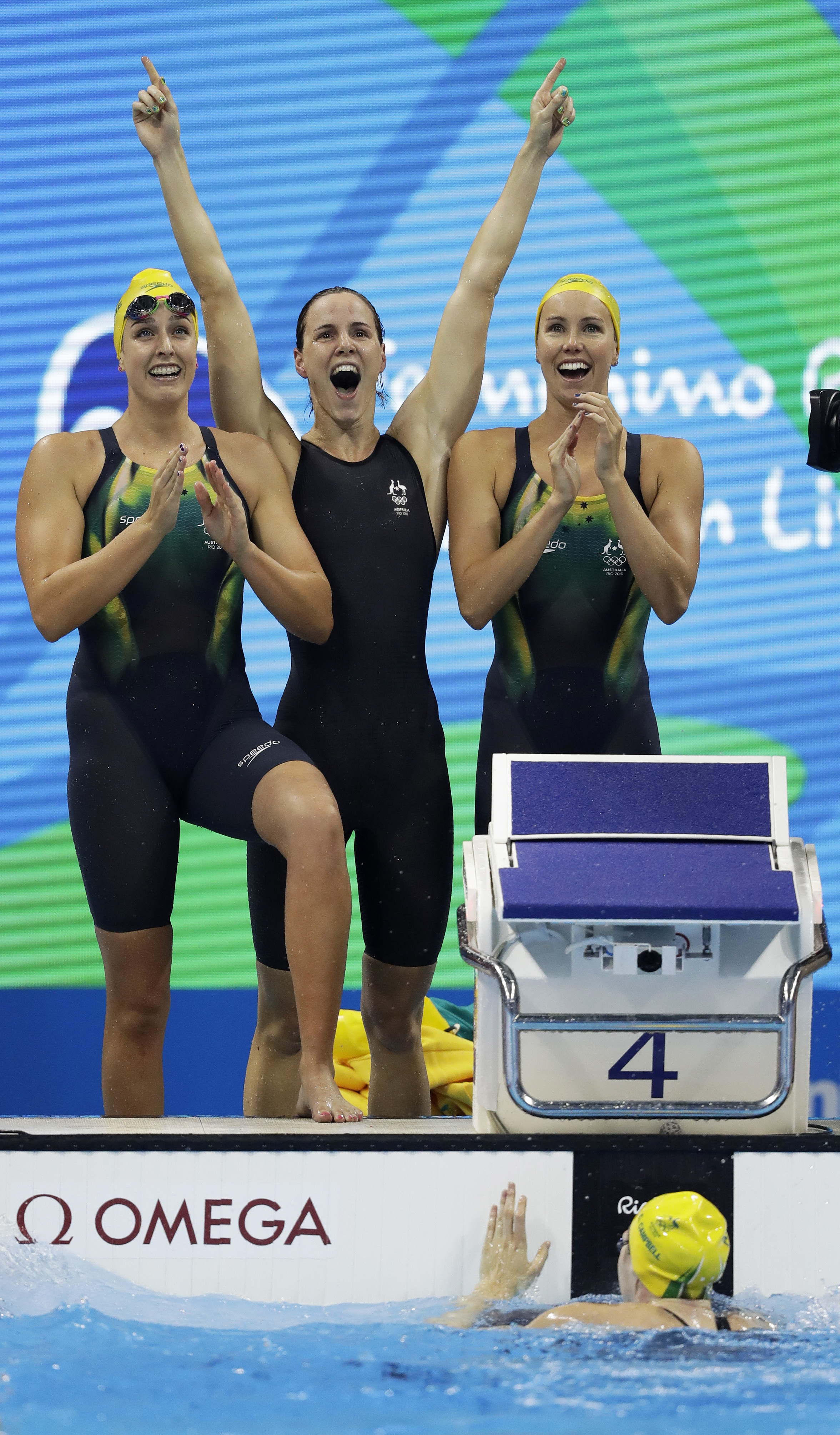 Australia's Emma McKeon, Brittany Elmslie and Bronte Campbell celebrate as Cate Campbell, bottom, finishes the women's 4x100-meter freestyle final setting a new world record during the swimming competitions at the 2016 Summer Olympics, Saturday, Aug. 6, 2