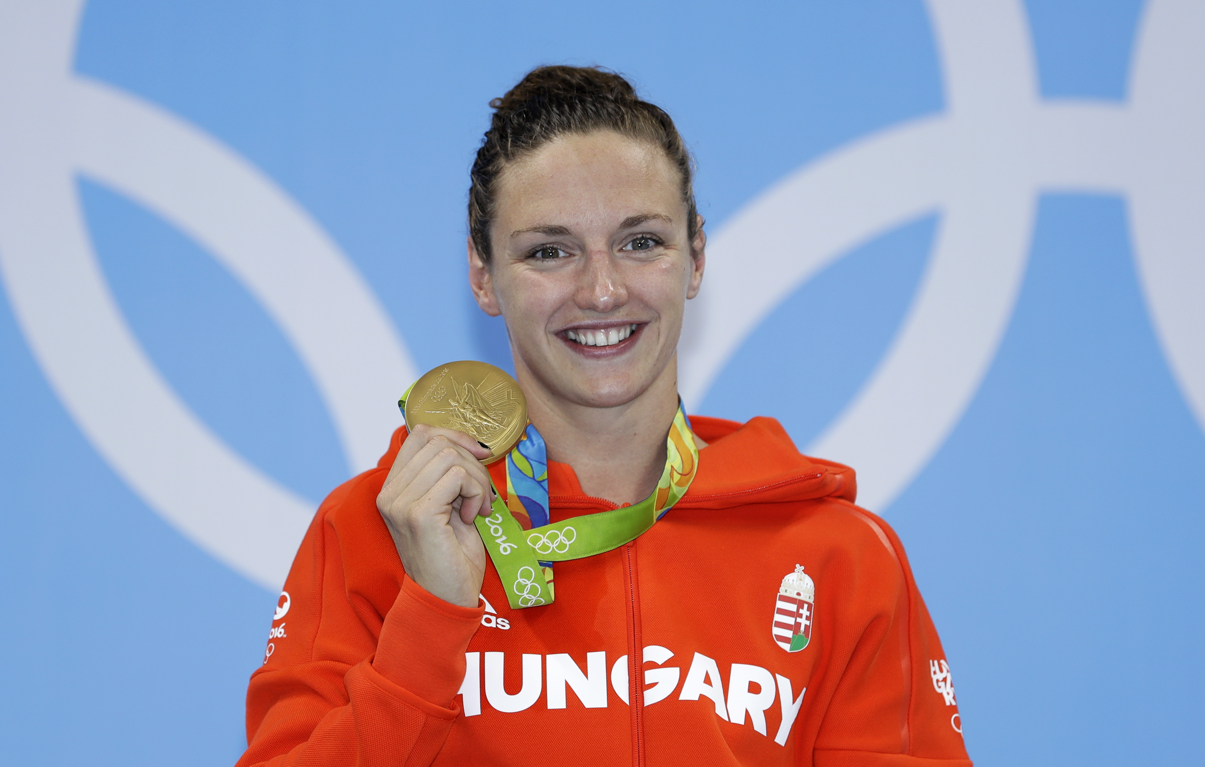 Hungary's Katinka Hosszu shows off her gold medal during the ceremony for the women's 400-meter individual medley final during the swimming competitions at the 2016 Summer Olympics, Saturday, Aug. 6, 2016, in Rio de Janeiro, Brazil. (AP Photo/Michael Sohn