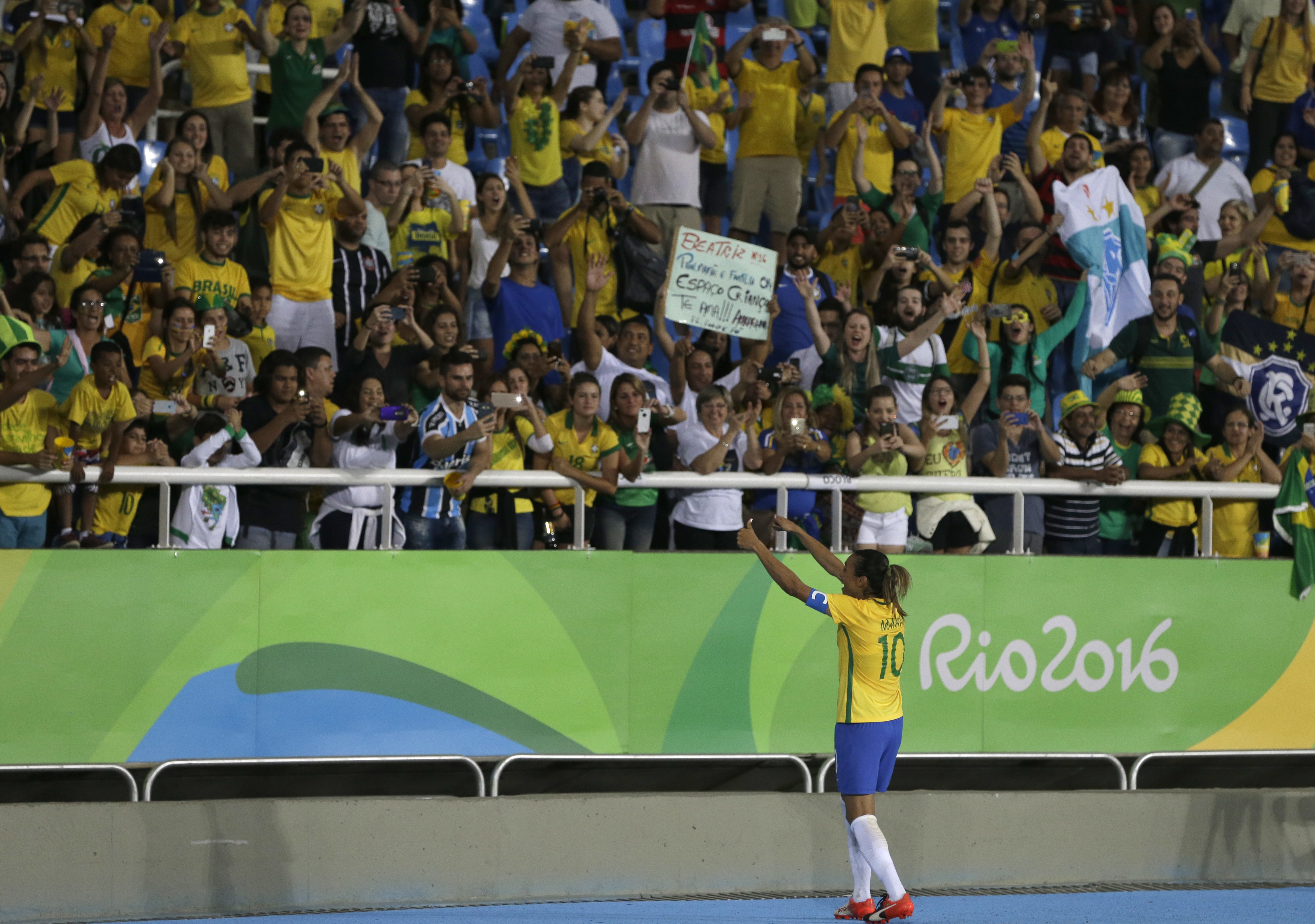 Brazil's Marta celebrates her team's victory with the crowd after a group E match of the women's Olympic football tournament between Sweden and Brazil at the Rio Olympic Stadium in Rio De Janeiro, Brazil, Saturday, Aug. 6, 2016. Brazil won the match 5-1.