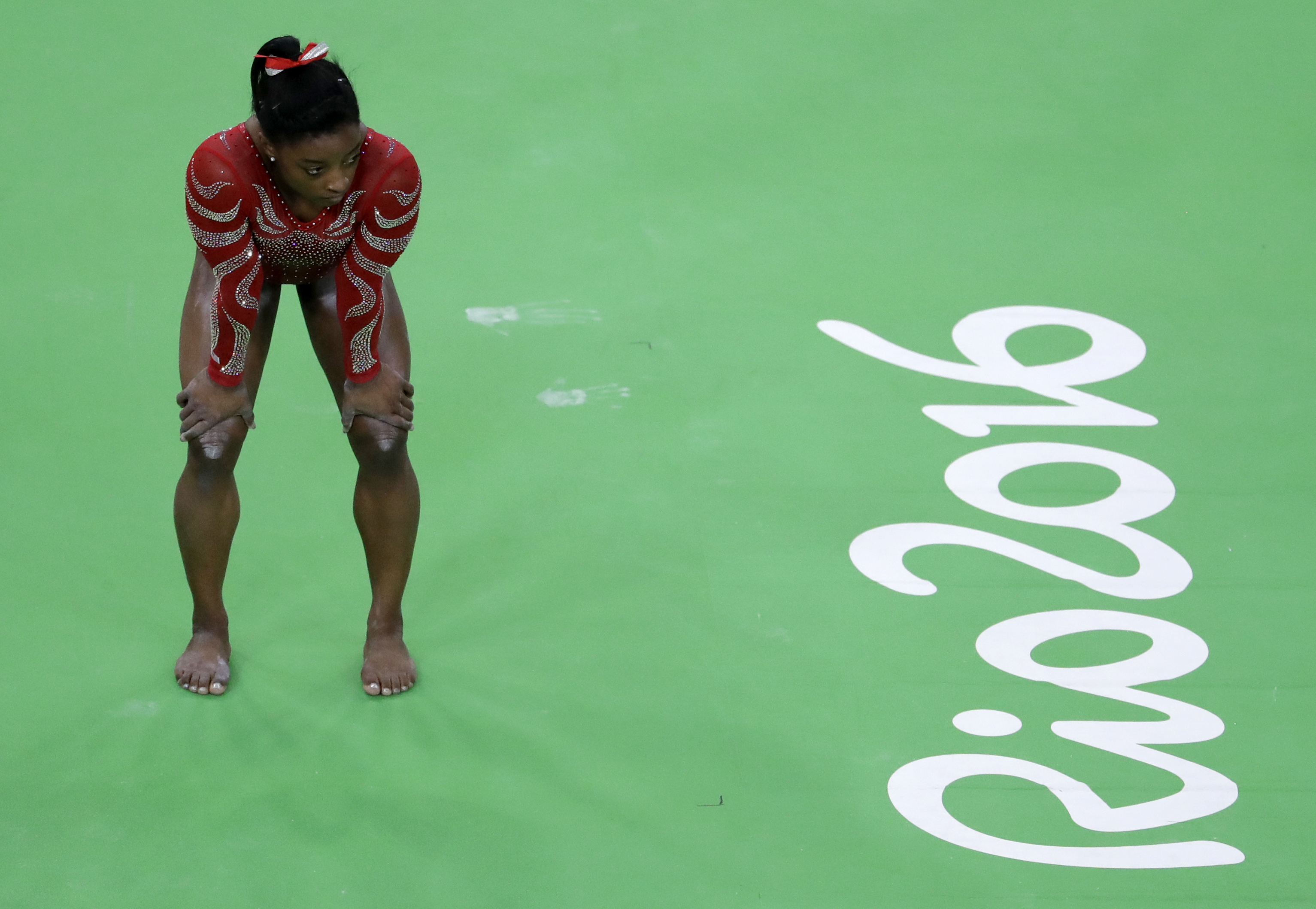FILE- In this Aug. 4, 2016 file photo United States' Simone Biles waits her turn to train on the beam ahead of the 2016 Summer Olympics in Rio de Janeiro, Brazil. It shouldn't come as a surprise that some of the best-recognized names on the U.S. Olympic t