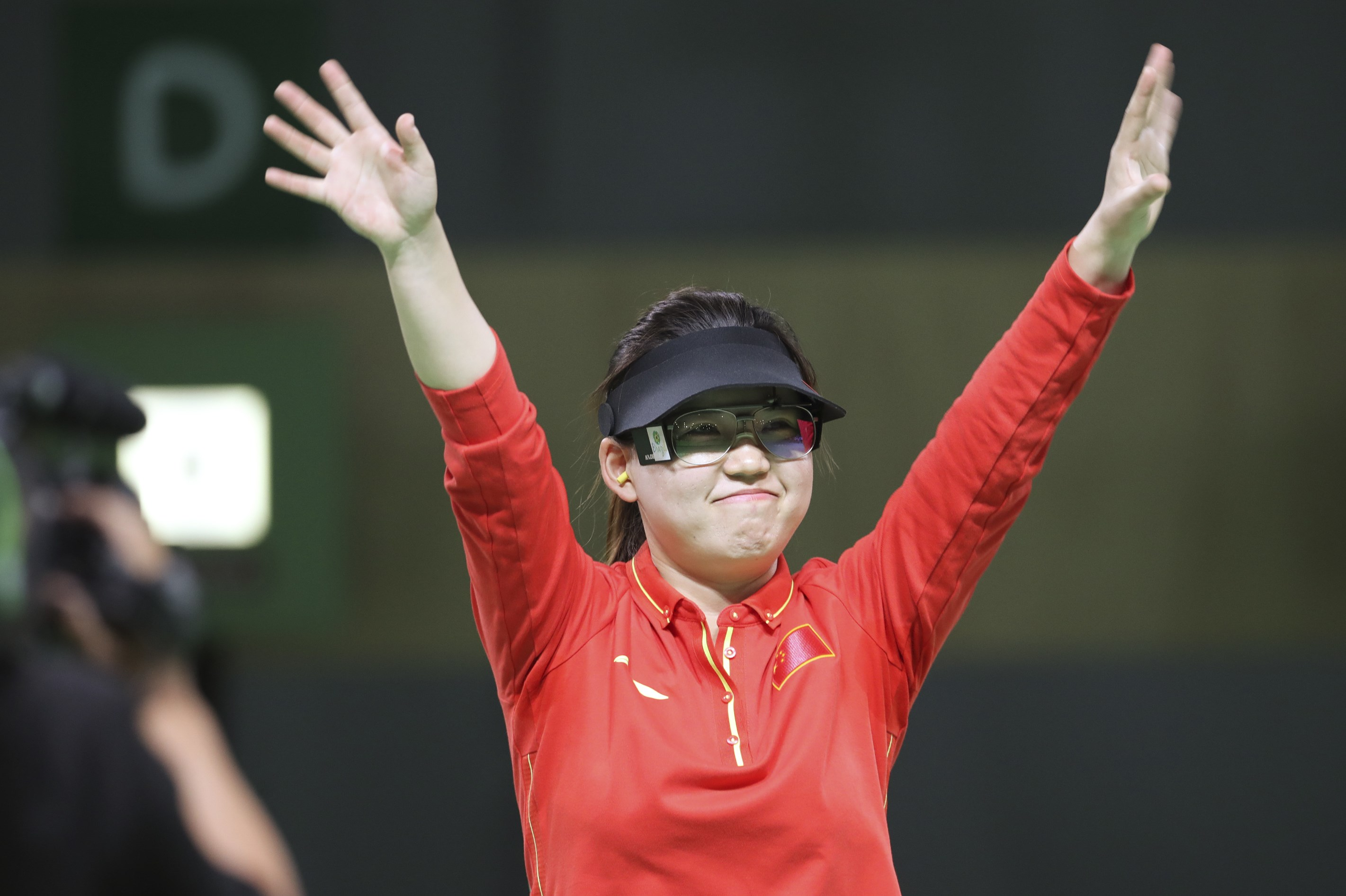 Zhang Mengxue of China celebrates her victory during the women's 10-meter air pistol finals at Olympic Shooting Center at the 2016 Summer Olympics in Rio de Janeiro, Brazil, Sunday, Aug. 7, 2016. Zhang won the gold medal. (AP Photo/Eugene Hoshiko)