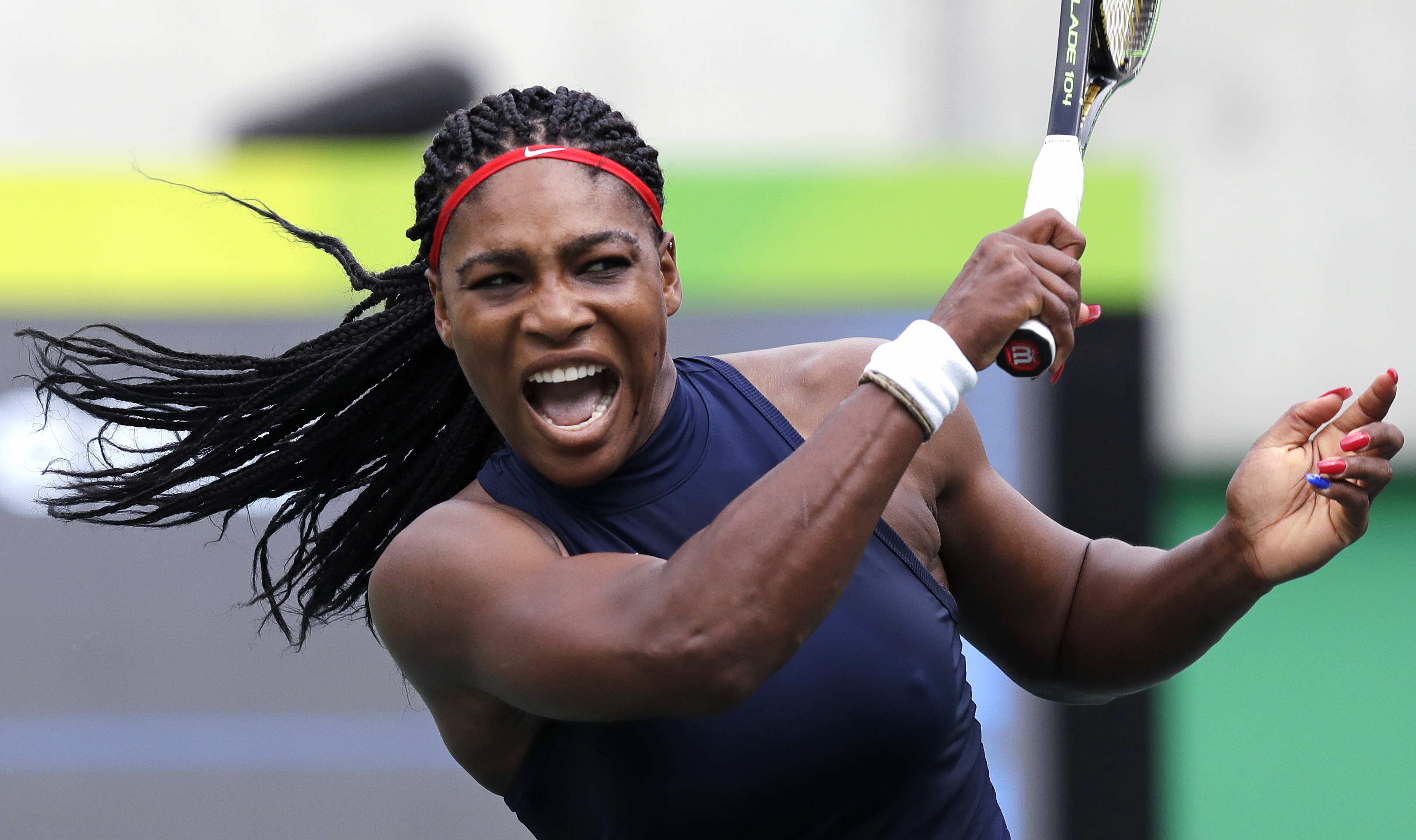 Serena Williams, of the United States, yells on a return against Daria Gavrilova, of Australia, at the 2016 Summer Olympics in Rio de Janeiro, Brazil, Sunday, Aug. 7, 2016. (AP Photo/Charles Krupa)