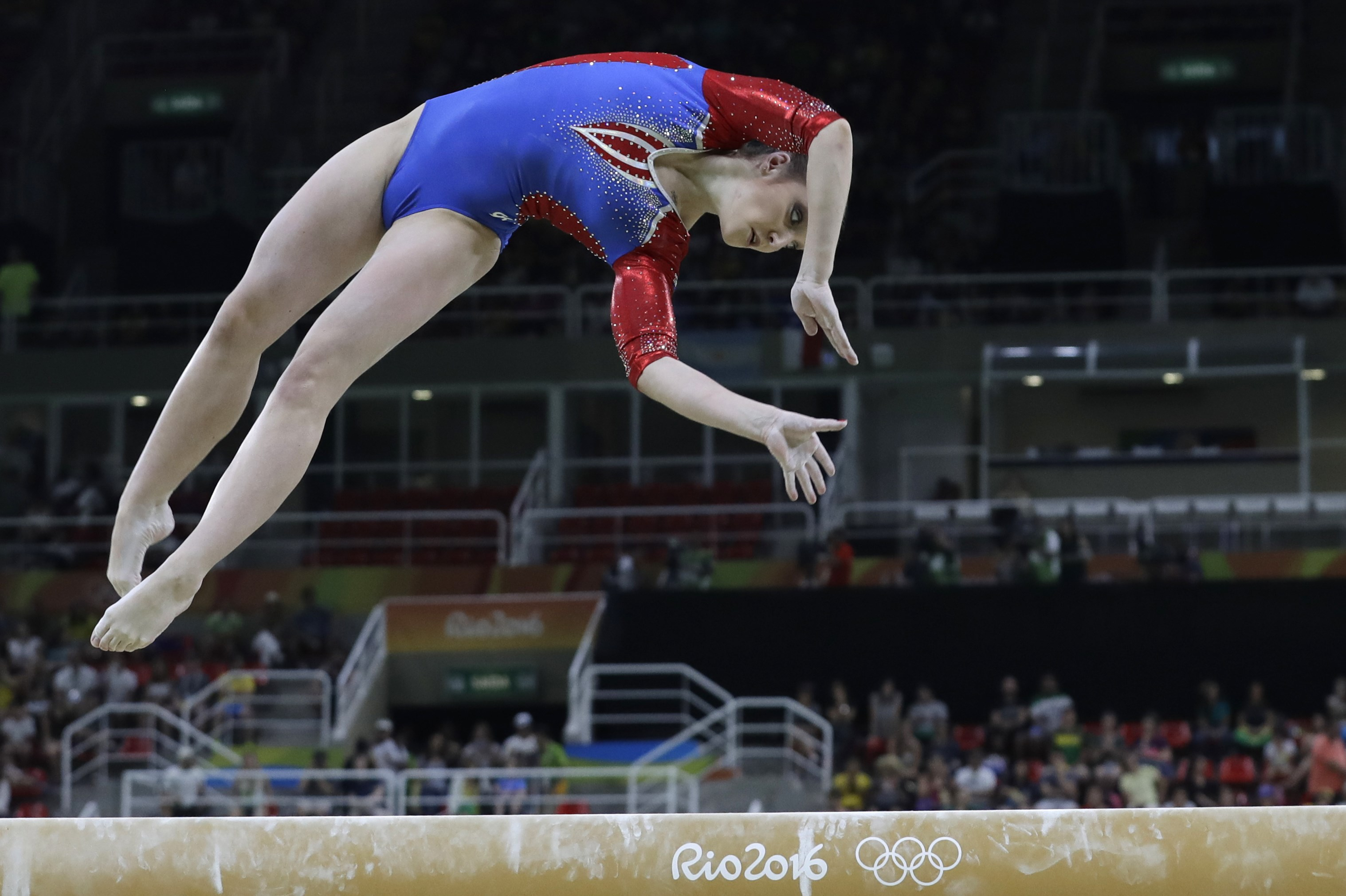 Russia's Aliya Mustafina performs on the balance beam during the artistic gymnastics women's qualification at the 2016 Summer Olympics in Rio de Janeiro, Brazil, Sunday, Aug. 7, 2016. (AP Photo/Rebecca Blackwell)