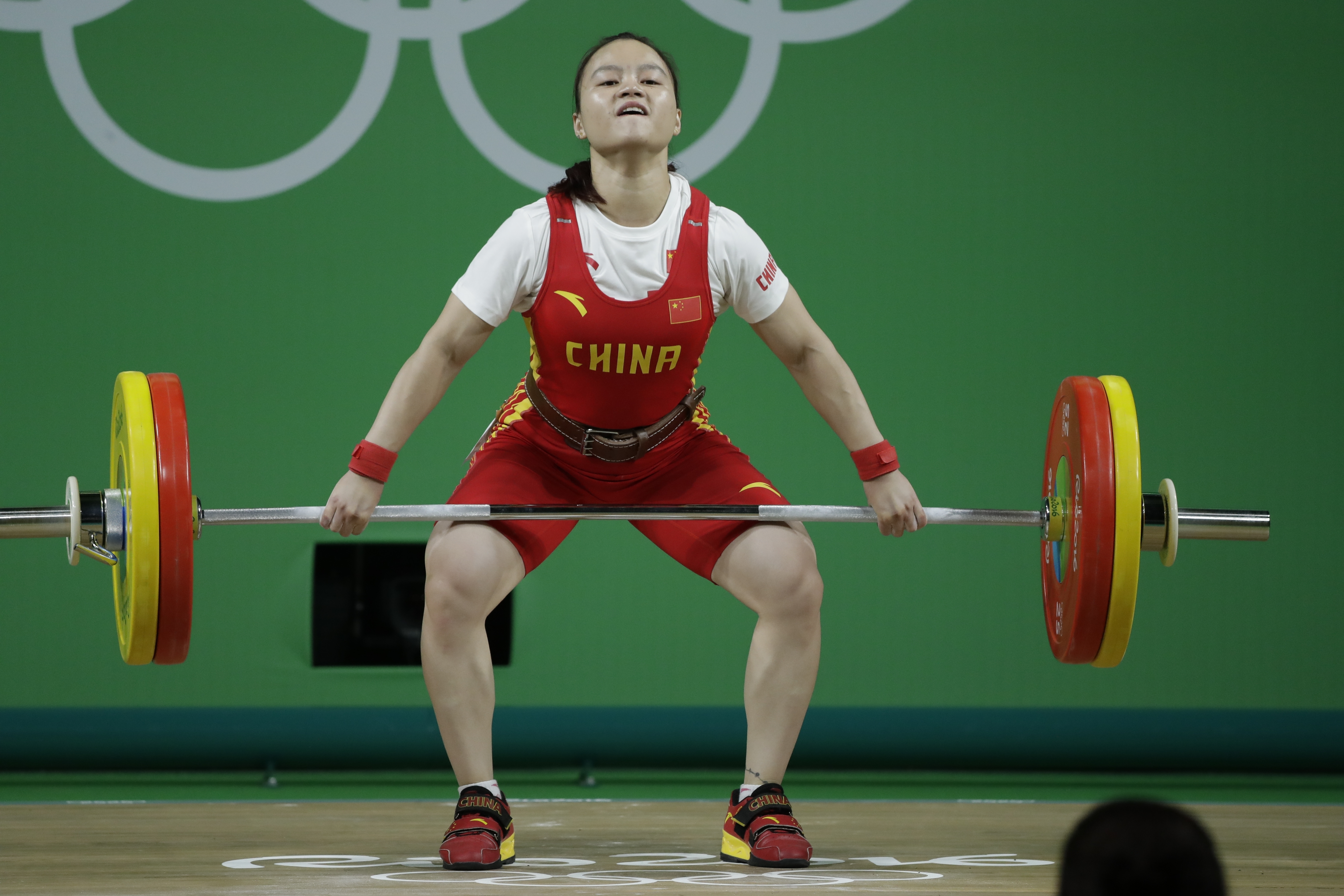 Li Yahun, of China, competes in the women's 53kg weightlifting competition at the 2016 Summer Olympics in Rio de Janeiro, Brazil, Sunday, Aug. 7, 2016. (AP Photo/Mike Groll)