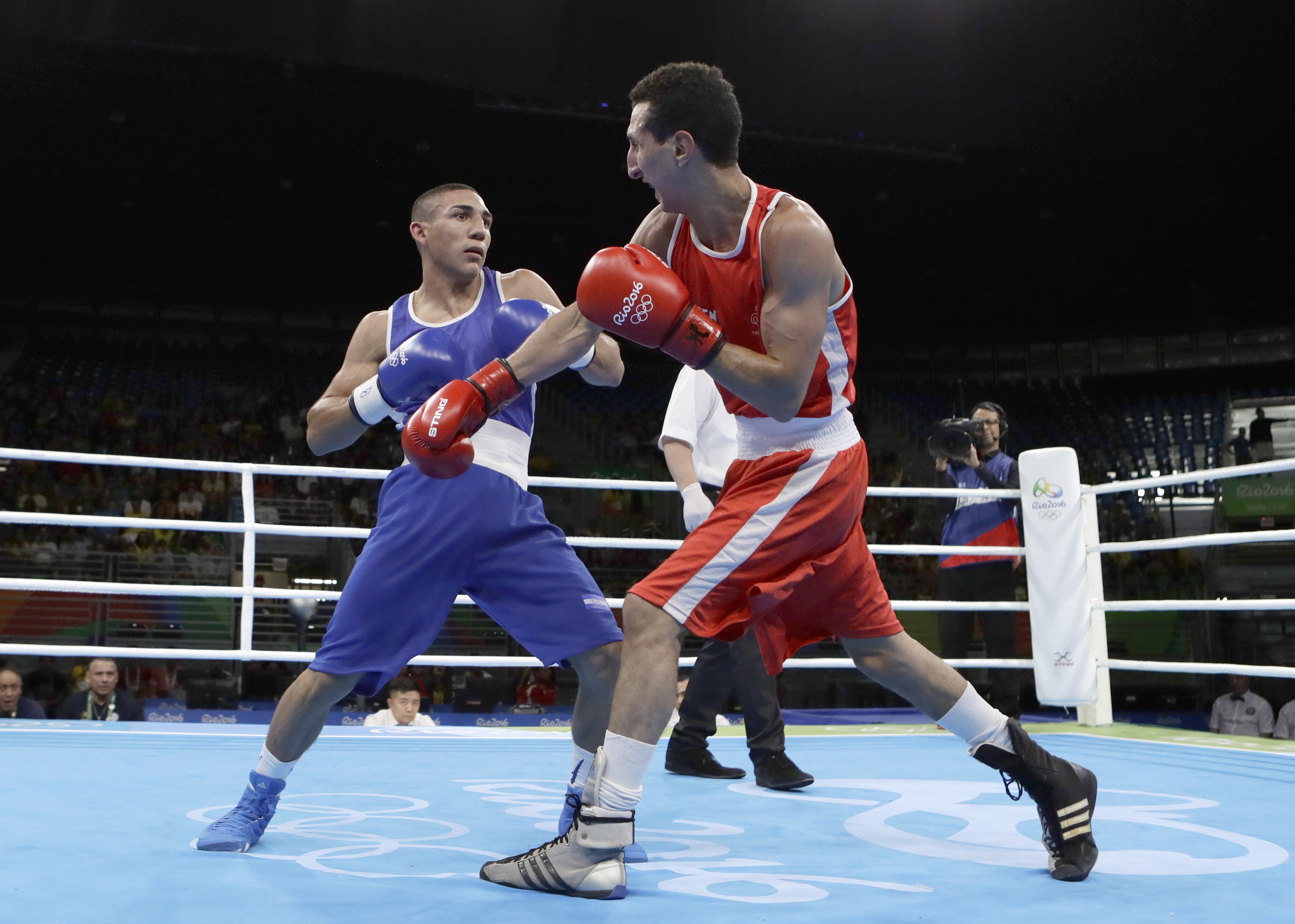 Honduras' Teofimo Andres Lopez Rivera, left, fights France's Sofiane Oumiha during a men's lightweight 60-kg preliminary boxing match at the 2016 Summer Olympics in Rio de Janeiro, Brazil, Sunday, Aug. 7, 2016. (AP Photo/Frank Franklin II)