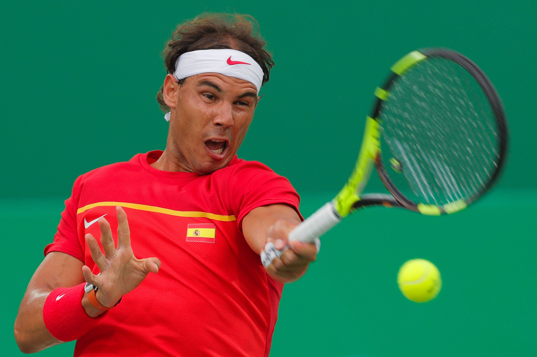 Rafael Nadal of Spain returns a ball to Federico Delbonis of Argentina during the men's tennis competition at the 2016 Summer Olympics in Rio de Janeiro, Brazil, Sunday, Aug. 7, 2016. (AP Photo/Vadim Ghirda)
