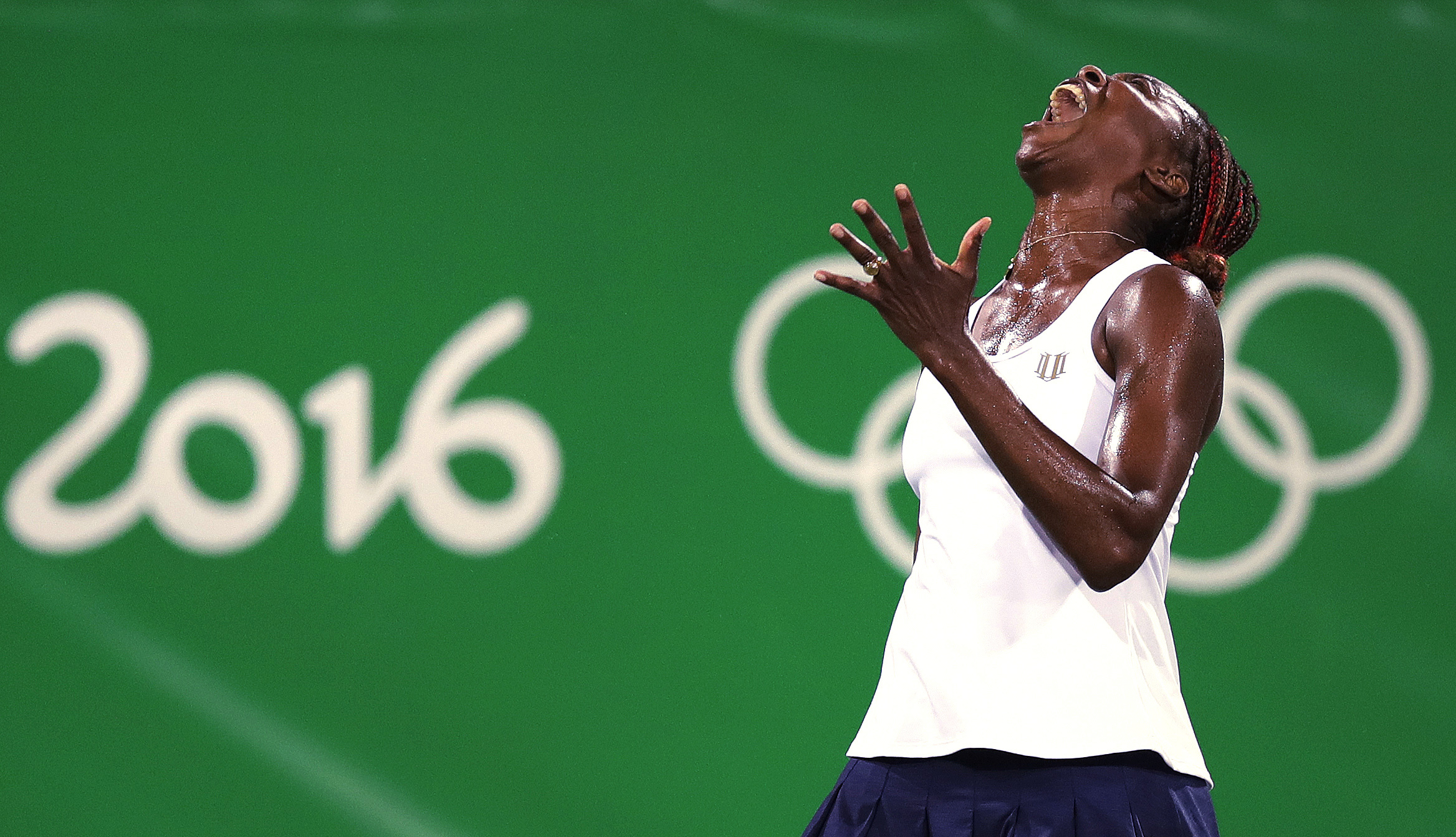 Venus Williams, of the United States, reacts after losing a point in a doubles match with her sister Serena against Lucie Safarova and Barbora Strycova, of the Czech Republic, at the 2016 Summer Olympics in Rio de Janeiro, Brazil, Sunday, Aug. 7, 2016. (A