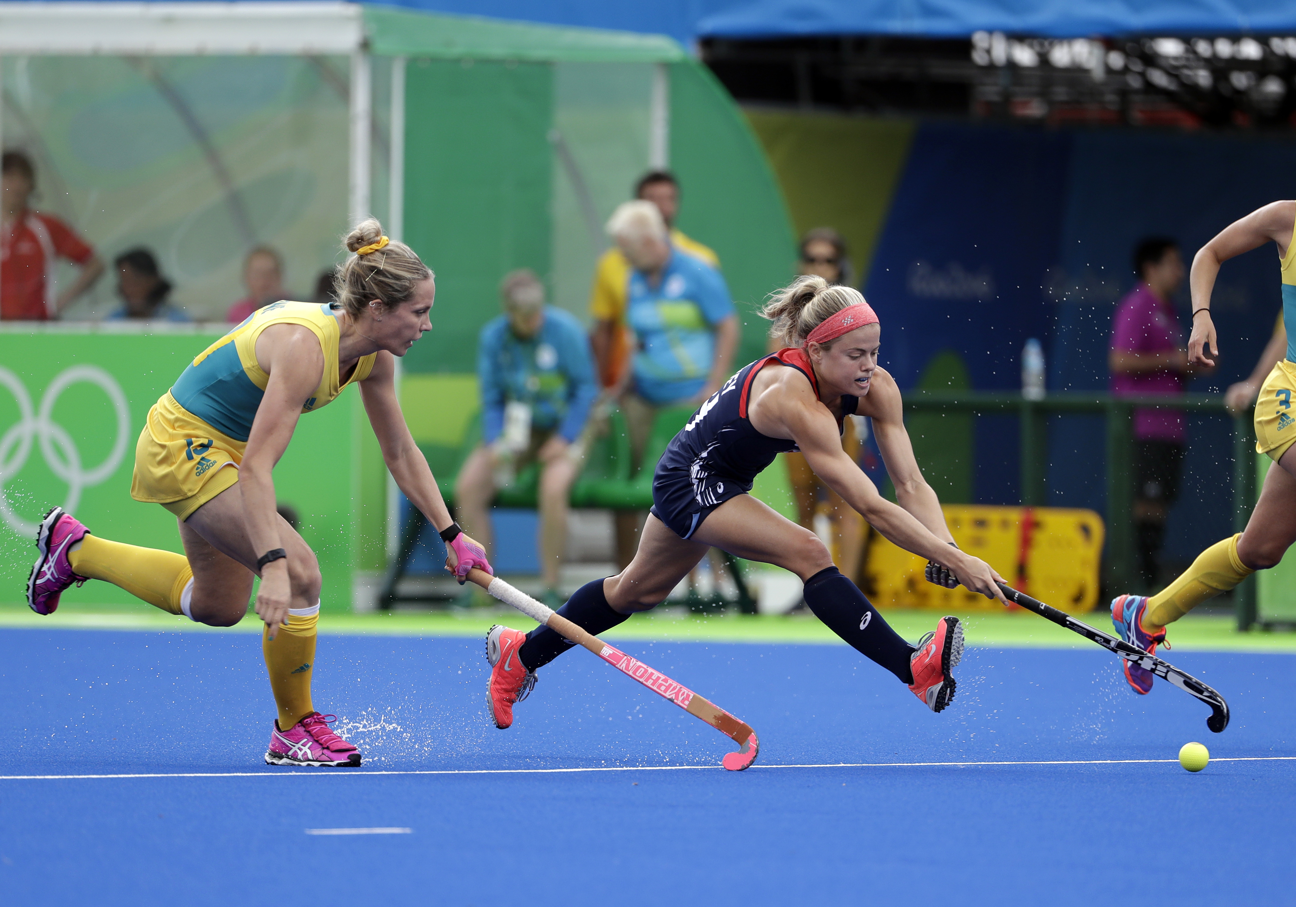 United States' Kathleen Sharkey, right, fights for the ball against Australia's Edwina Bone, left, during a women's field hockey match at 2016 Summer Olympics in Rio de Janeiro, Brazil, Monday, Aug. 8, 2016. (AP Photo/Hussein Malla)