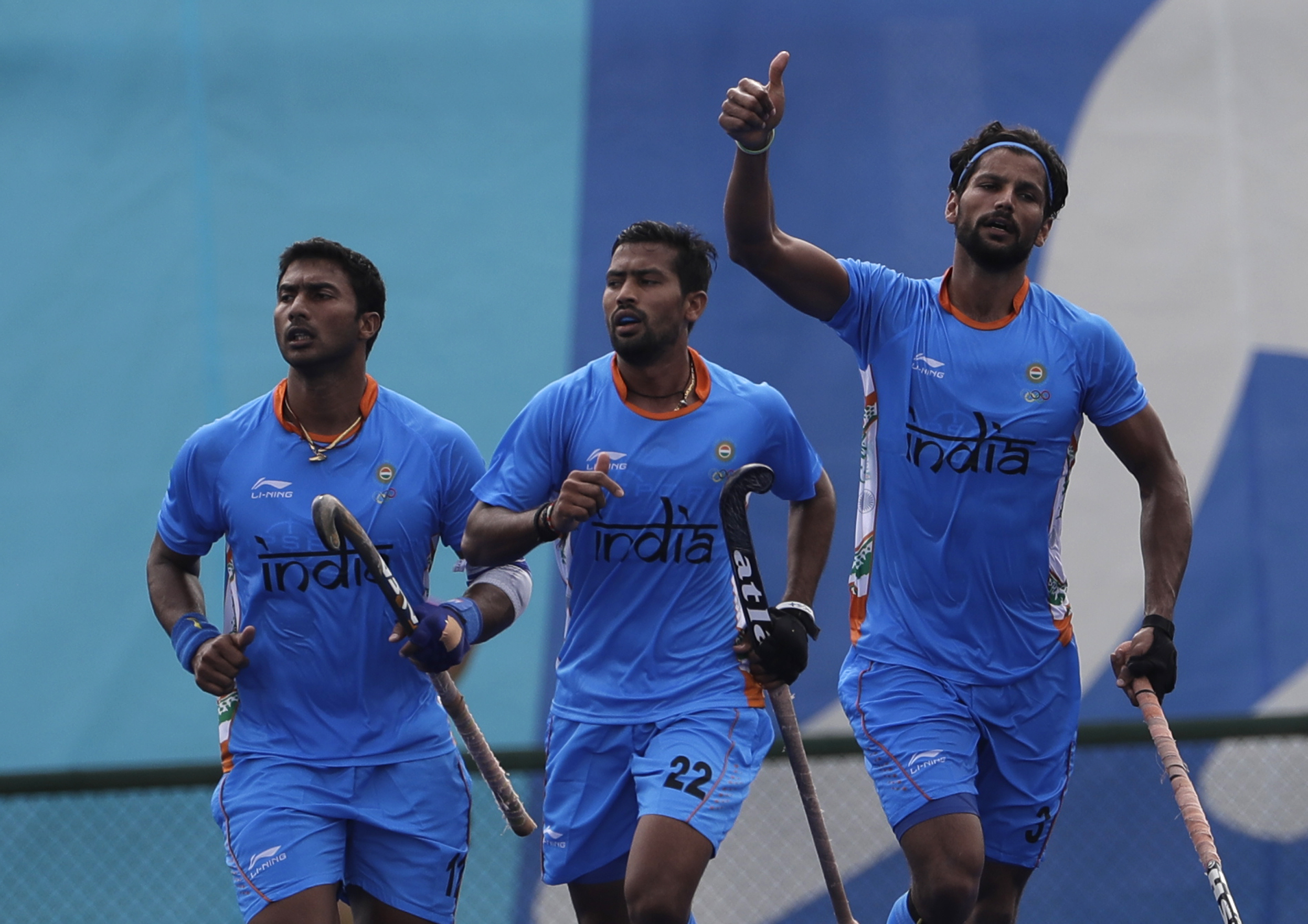 India's Rupinder Pal Singh, right, celebrates his goal against Germany during a men's field hockey match at 2016 Summer Olympics in Rio de Janeiro, Brazil, Monday, Aug. 8, 2016. (AP Photo/Hussein Malla)