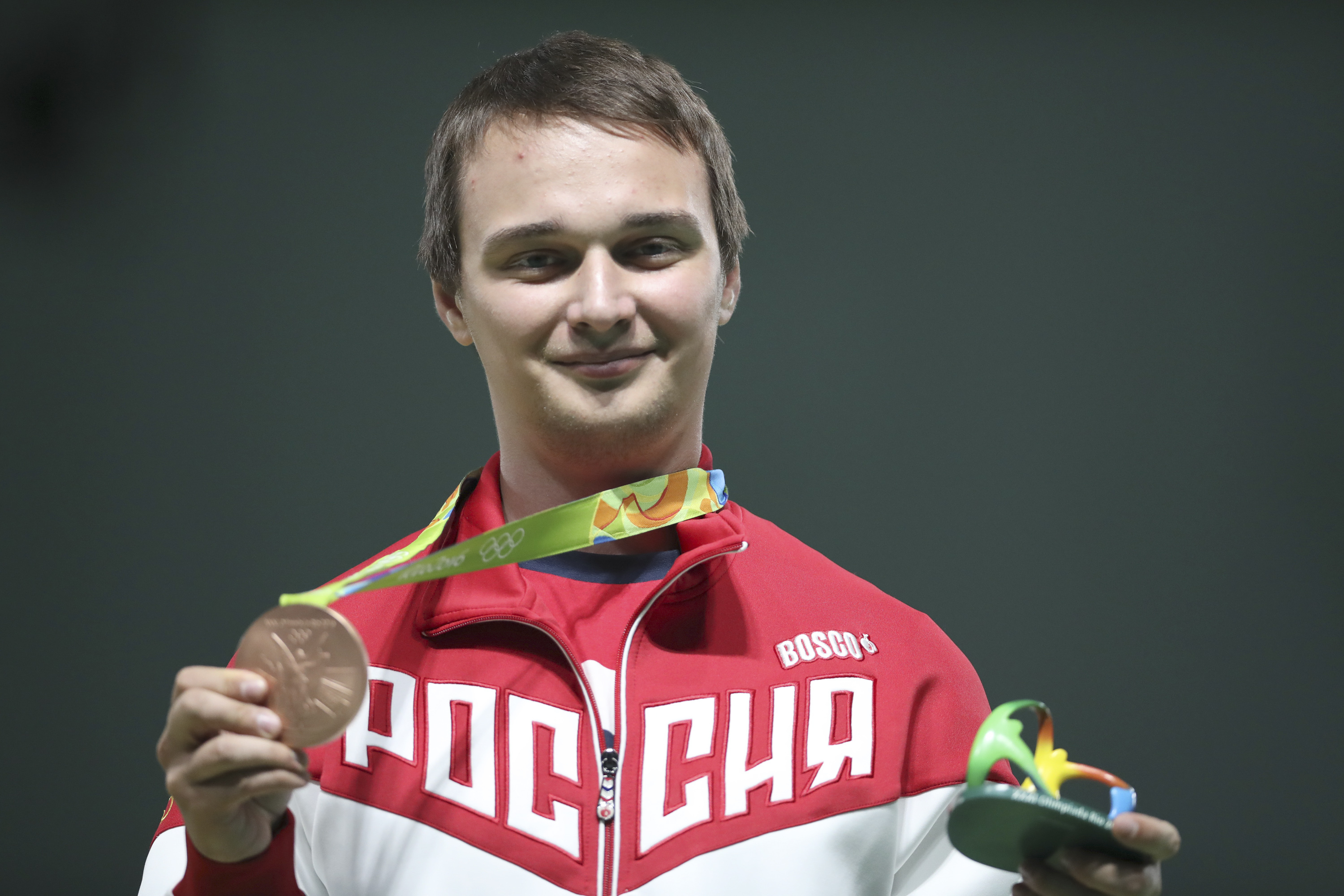 Vladimir Maslennikov of Russia celebrates with his bronze medal during the award ceremony for men's 10 meter air rifle at Olympic Shooting Center at the 2016 Summer Olympics in Rio de Janeiro, Brazil, Monday, Aug. 8, 2016. (AP Photo/Eugene Hoshiko)