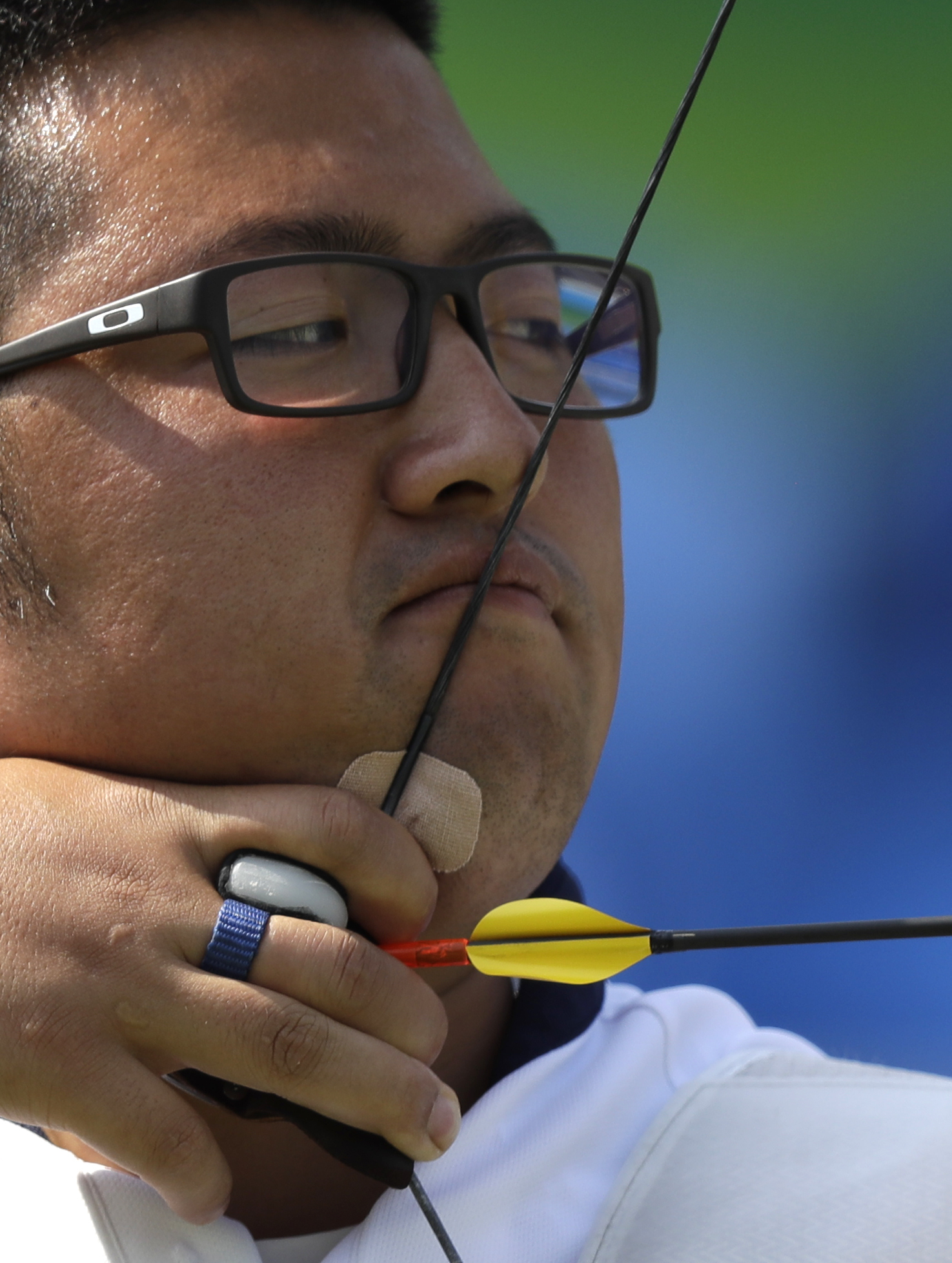 South Korea's Kim Woo-jin releases his arrow during his match against Indonesia's Riau Ega Agatha in an elimination round of the individual archery competition at the Sambadrome venue during the 2016 Summer Olympics in Rio de Janeiro, Brazil, Monday, Aug.