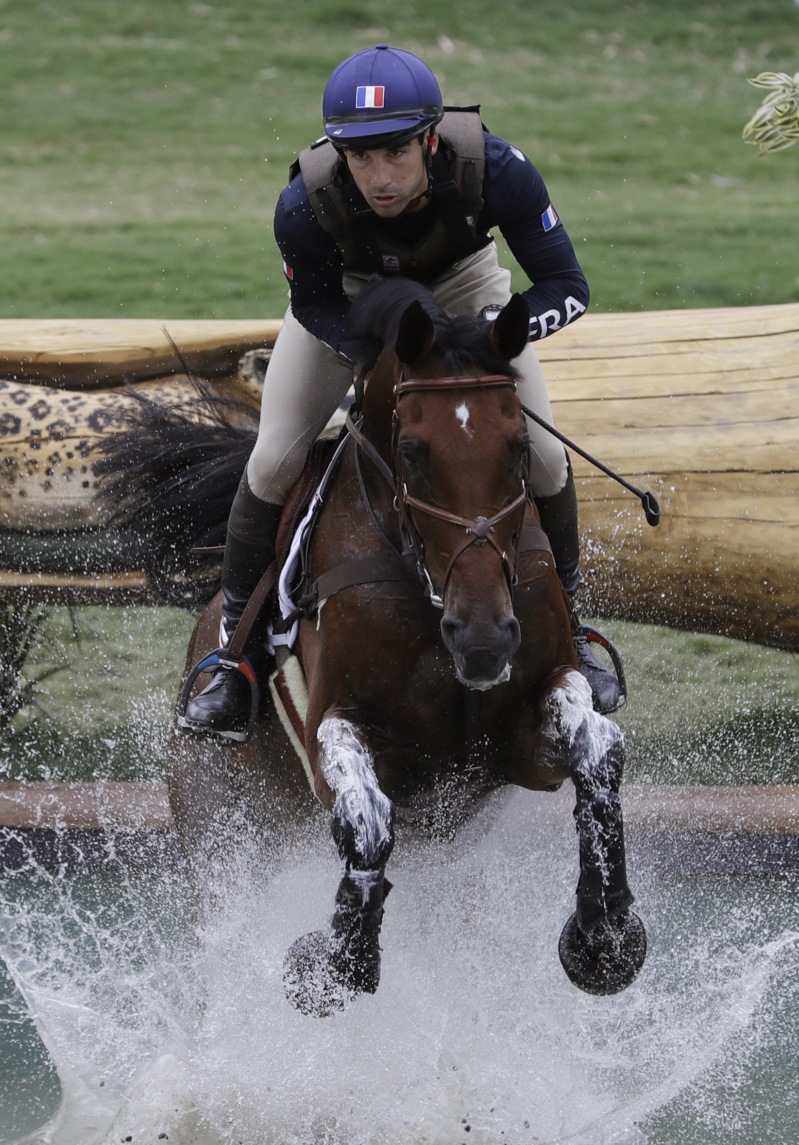 Astier Nicolas, of France, competes on Piaf de b'Neville in the equestrian eventing cross country phase at the 2016 Summer Olympics in Rio de Janeiro, Brazil, Monday, Aug. 8, 2016. (AP Photo/John Locher)