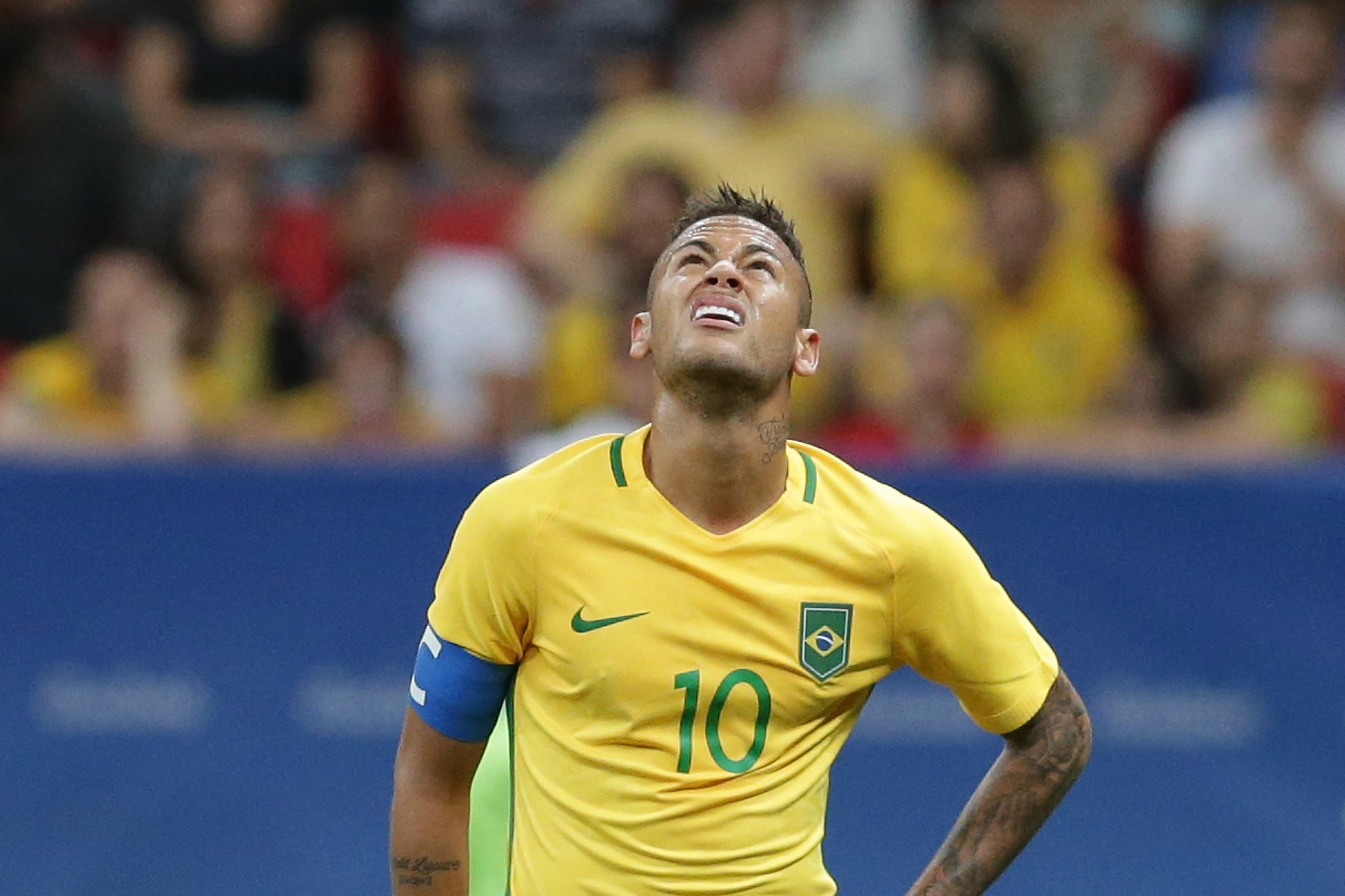 Brazil's Neymar grimaces at the end of a group A match of the men's Olympic football tournament between Brazil and Iraq at the National Stadium in Brasilia, Brazil, Sunday, Aug. 7, 2016. The game ended in a 0-0 draw. (AP Photo/Eraldo Peres)