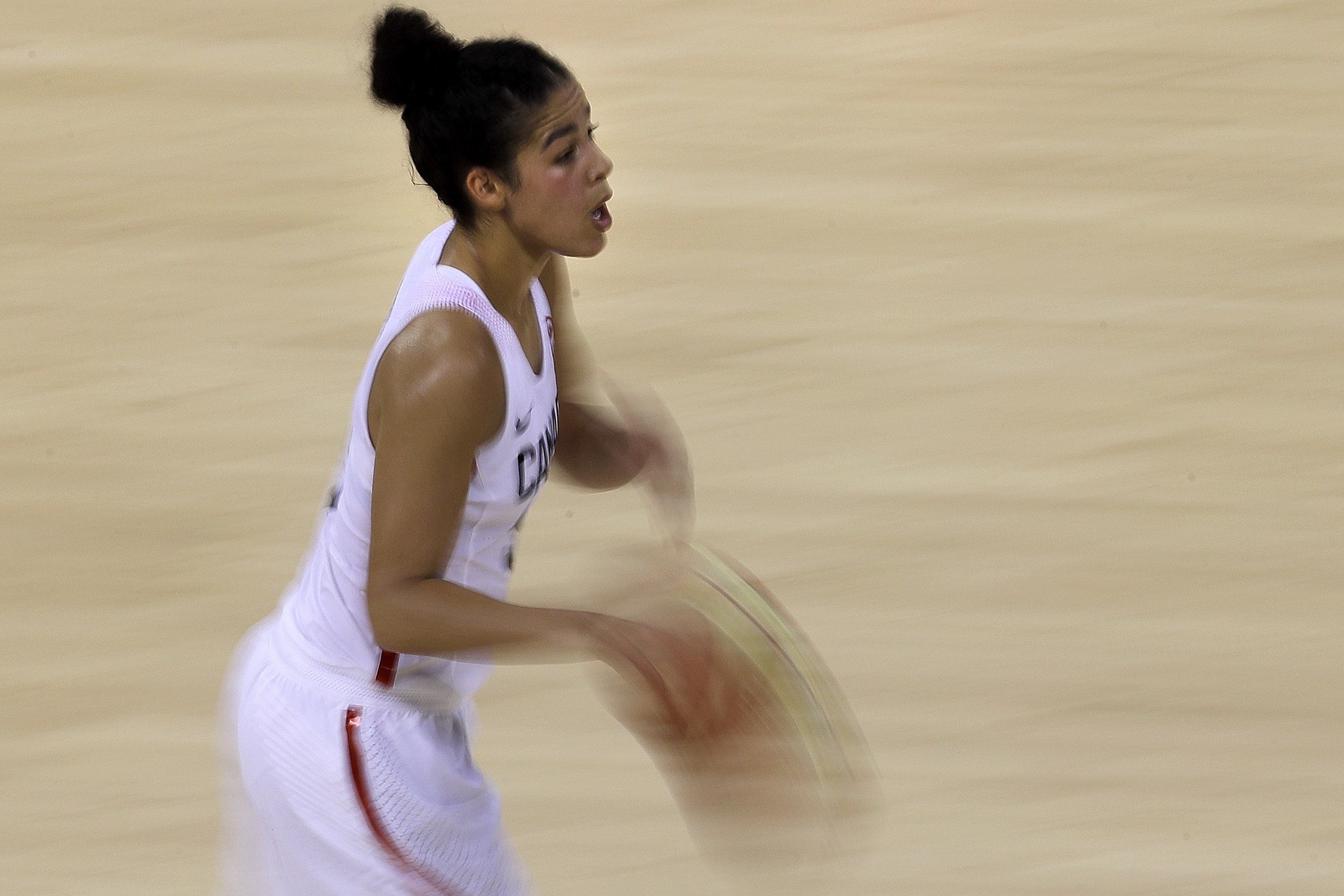 Canada's Kia Nurse drives with the ball during the second half of a women's basketball game against Serbia at the 2016 Summer Olympics in Rio de Janeiro, Brazil, Monday, Aug. 8, 2016. Canada won 71-67. (AP Photo/Charlie Riedel)