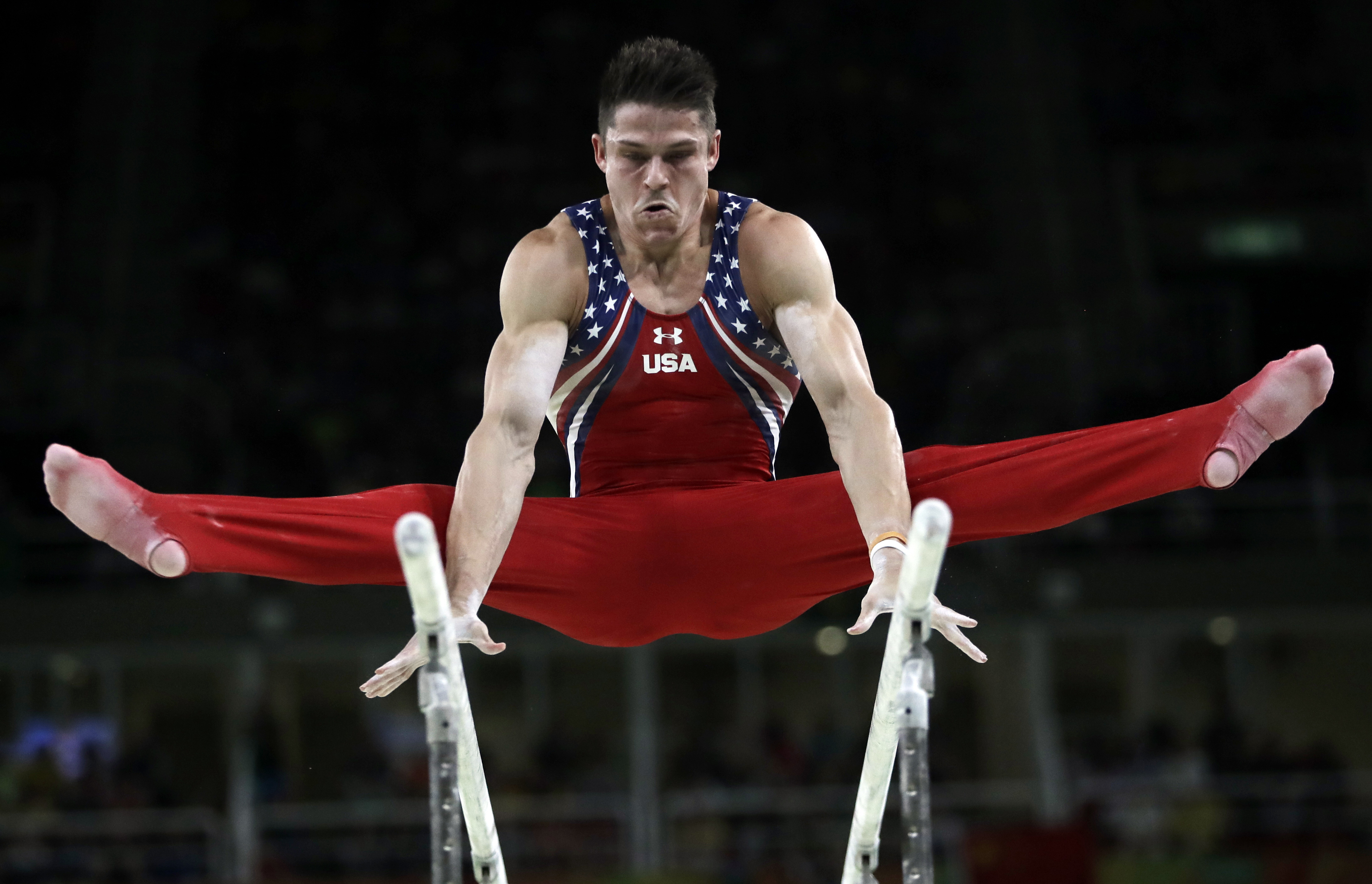 United States' Chris Brooks performs on the parallel bars during the artistic gymnastics men's team final at the 2016 Summer Olympics in Rio de Janeiro, Brazil, Monday, Aug. 8, 2016. (AP Photo/Julio Cortez)