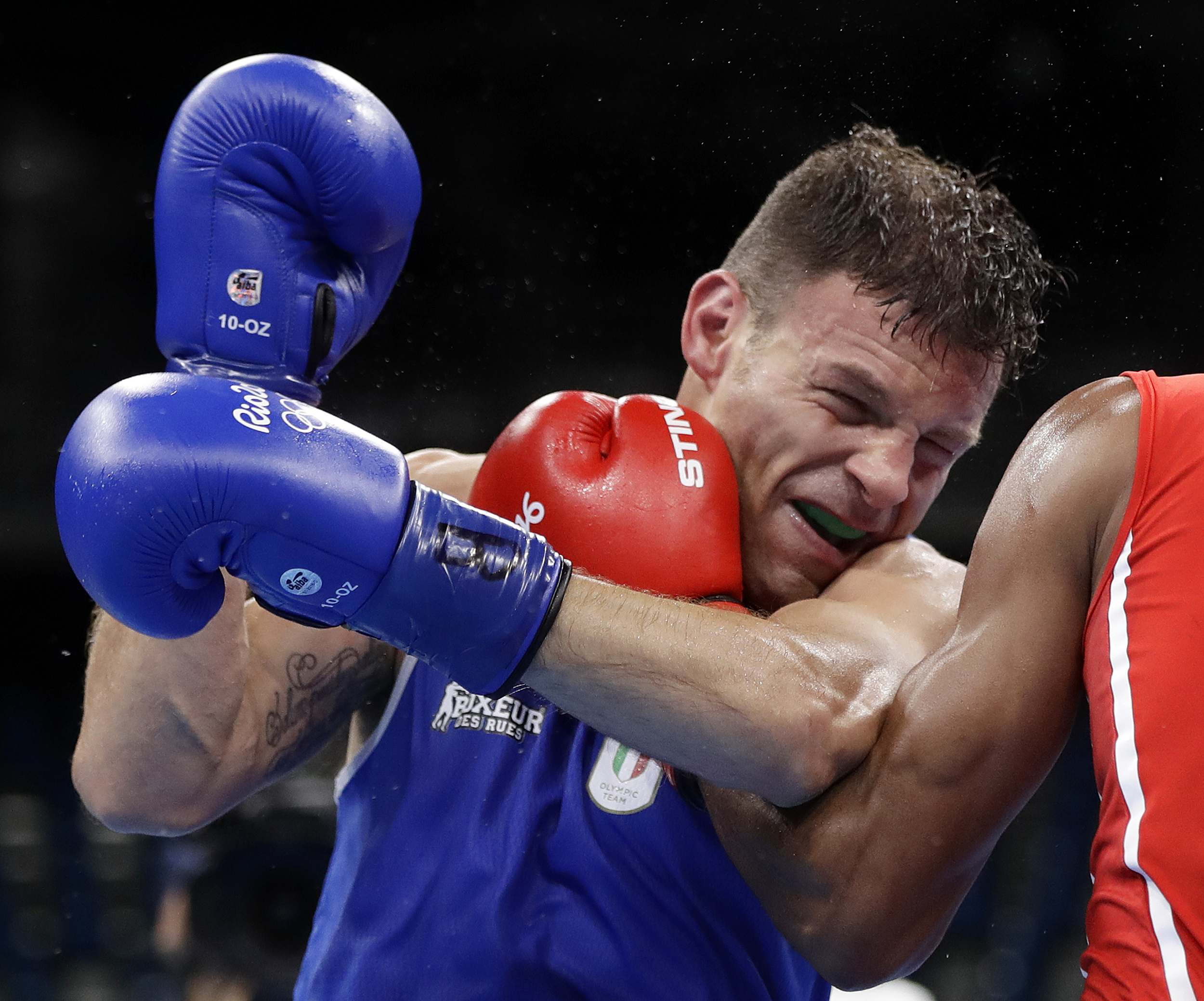 Italy's Carmine Tommasone fights Cuba's Lazaro Alvarez during a men's lightweight 60-kg preliminary boxing match at the 2016 Summer Olympics in Rio de Janeiro, Brazil, Tuesday, Aug. 9, 2016. (AP Photo/Frank Franklin II)