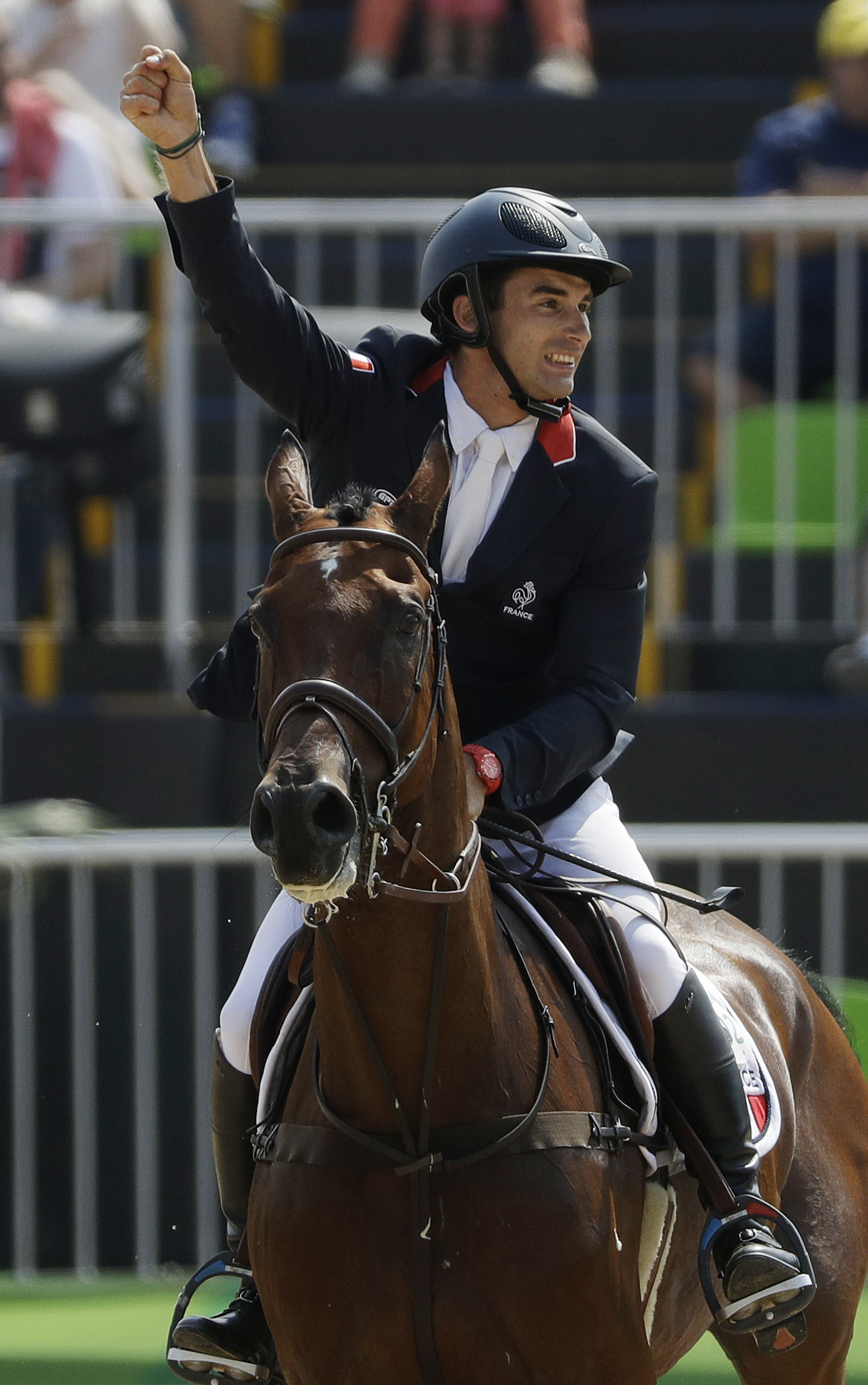 Astier Nicolas, of France, riding Piafde B'Neville, celebrates after competing in the equestrian eventing team show jumping phase at the 2016 Summer Olympics in Rio de Janeiro, Brazil, Tuesday, Aug. 9, 2016. (AP Photo/John Locher)