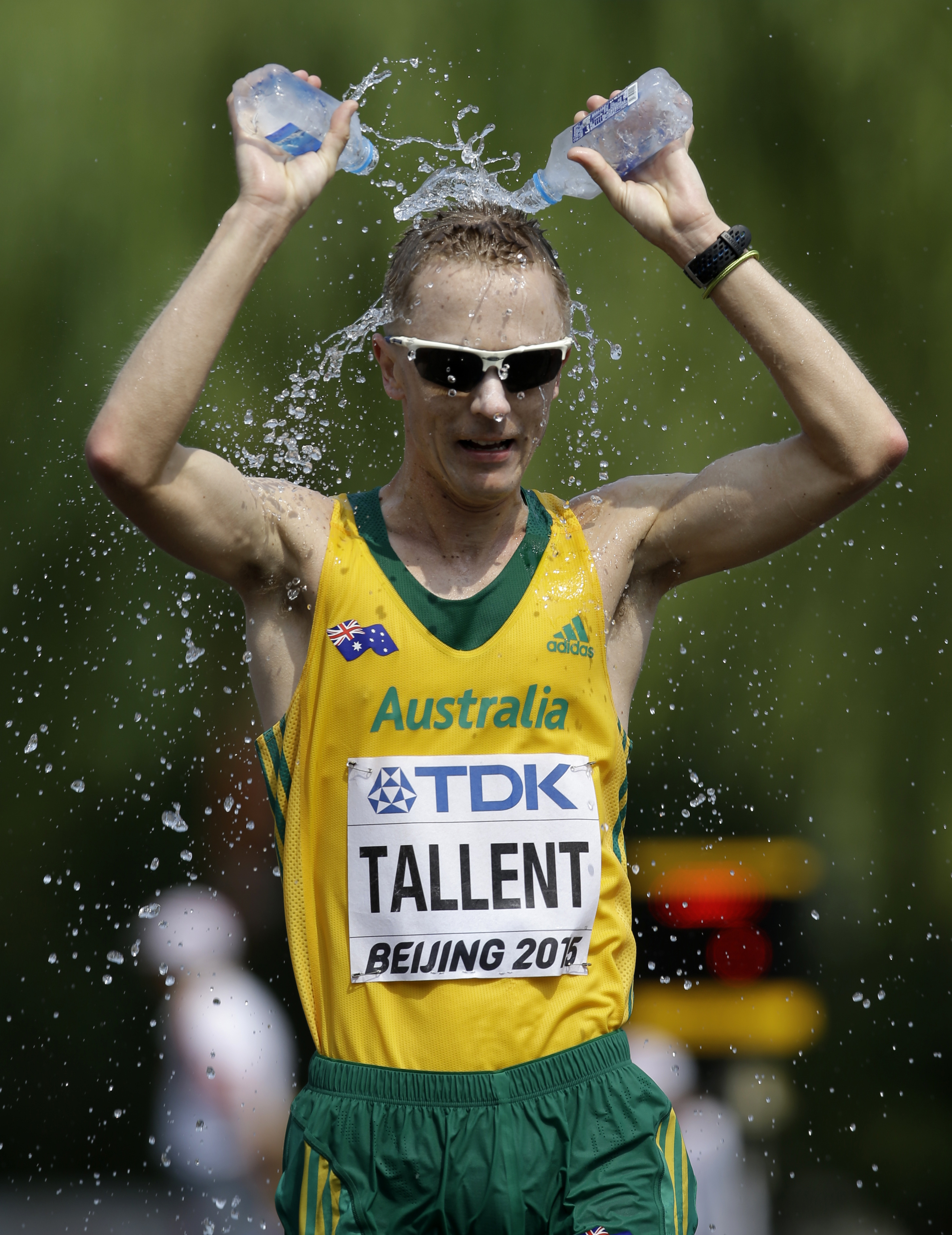FILE - In this Aug. 29, 2015 file photo, Australia's Jared Tallent grimaces after dousing himself with water during the men's 50k race walk at the World Athletics Championships outside the Bird's Nest stadium in Beijing. Tallent says race walking is bette