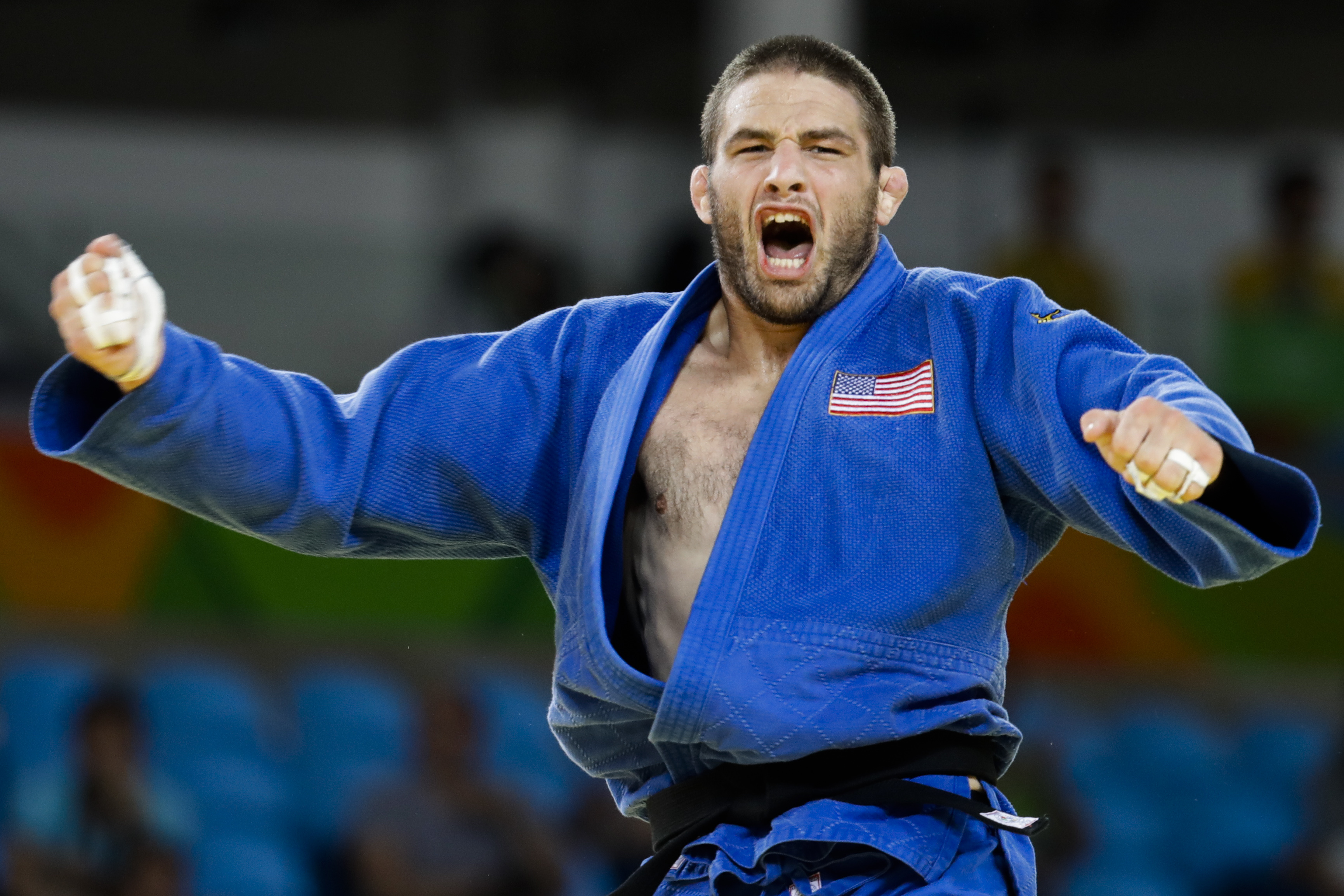 United States' Travis Stevens reacts after winning the semi-final of the men's 81-kg judo competition at the 2016 Summer Olympics in Rio de Janeiro, Brazil, Tuesday, Aug. 9, 2016. (AP Photo/Markus Schreiber)