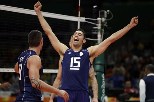 Italy's Emanuele Birarelli (15) celebrates with teammate Filippo Lanza during a men's preliminary volleyball match against France at the 2016 Summer Olympics in Rio de Janeiro, Brazil, Sunday, Aug. 7, 2016. (AP Photo/Matt Rourke)