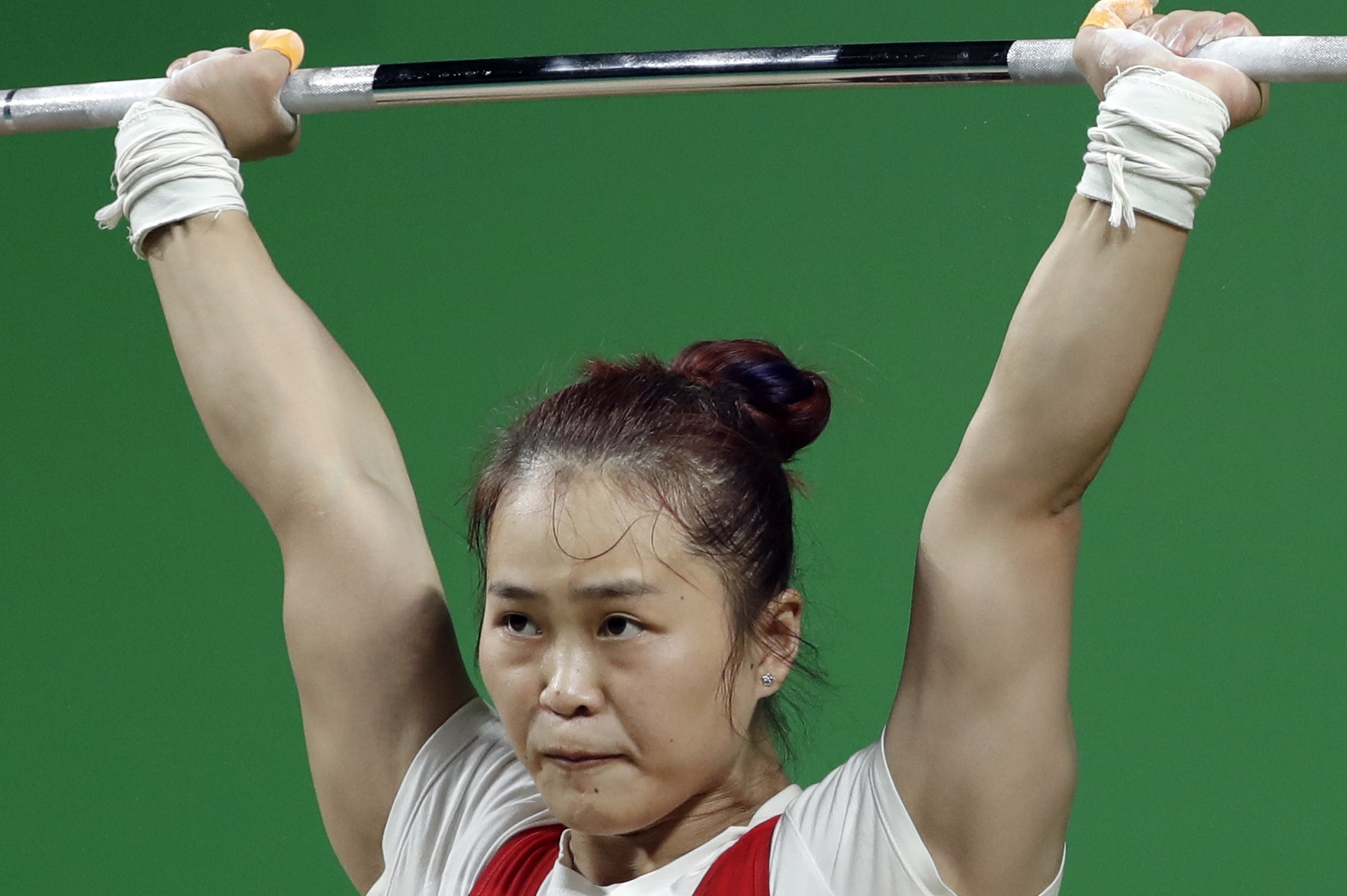 Deng Wei, of China, competes in the women's 63kg weightlifting competition at the 2016 Summer Olympics in Rio de Janeiro, Brazil, Tuesday, Aug. 9, 2016. (AP Photo/Mike Groll)