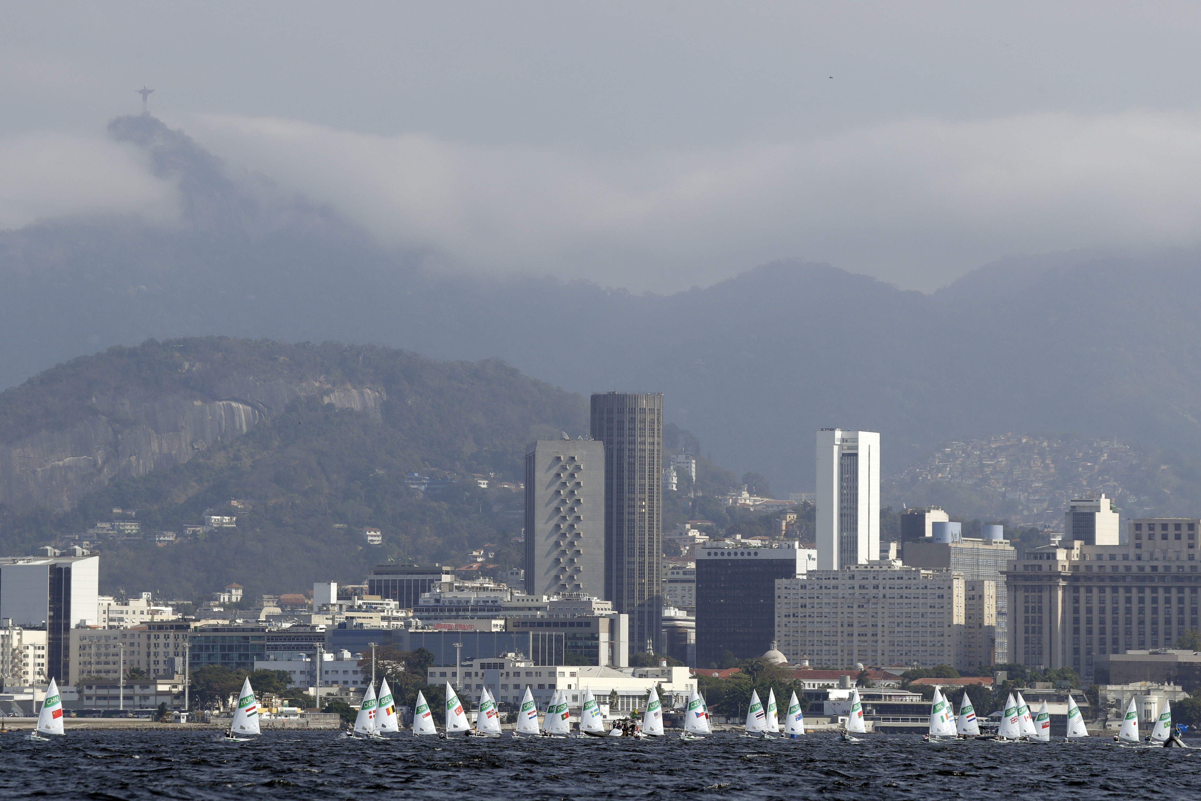 Athletes sail in the Guanabara bay during the Laser Radial women race at the 2016 Summer Olympics in Rio de Janeiro, Brazil, Tuesday, Aug. 9, 2016. (AP Photo/Gregorio Borgia)