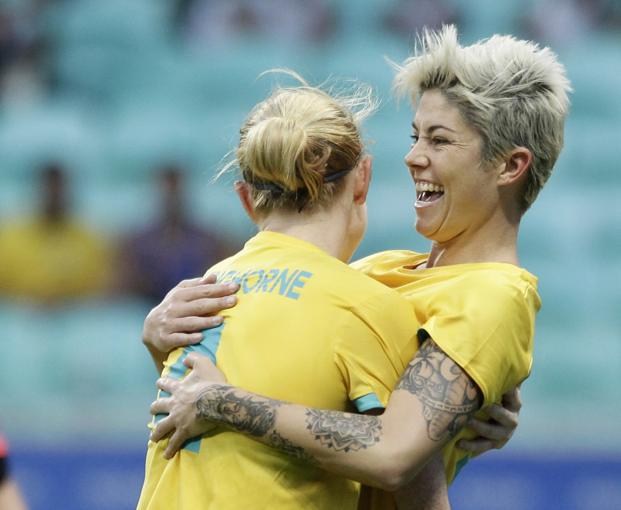Australia's Michelle Heyman, right, celebrates her goal with Australia's Clare Polkinghorne during a group F match of the women's Olympic football tournament between Australia and Zimbabwe at the Fonte Nova Arena in Salvador, Brazil, Tuesday, Aug. 9, 2016
