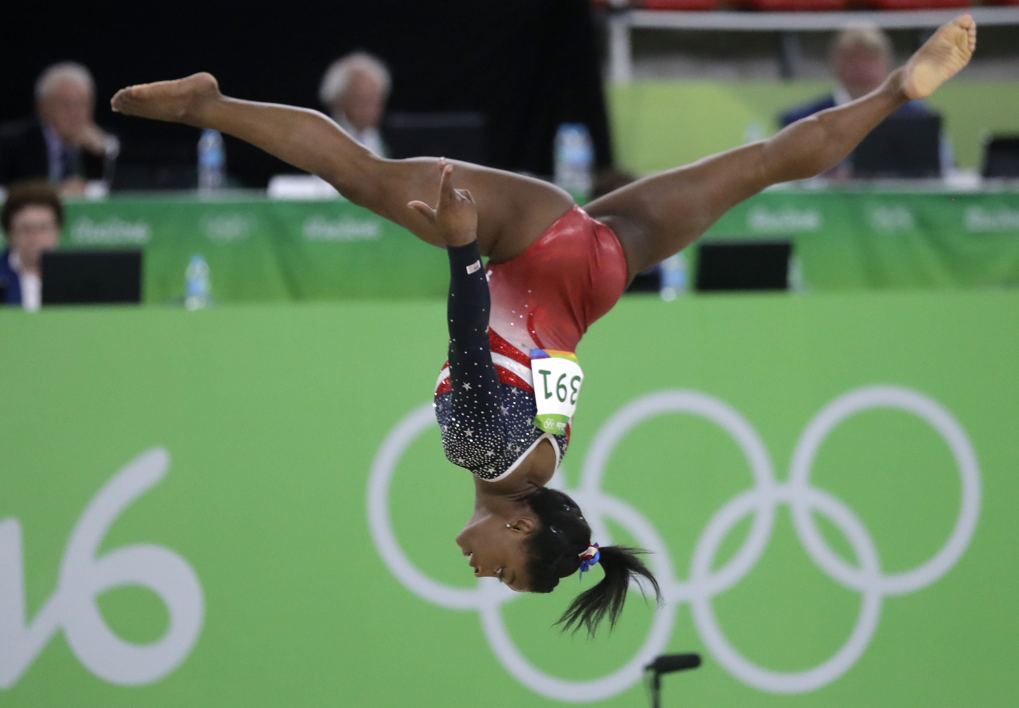 United States' Simone Biles performs on the floor during the artistic gymnastics women's team final at the 2016 Summer Olympics in Rio de Janeiro, Brazil, Tuesday, Aug. 9, 2016. (AP Photo/Julio Cortez)