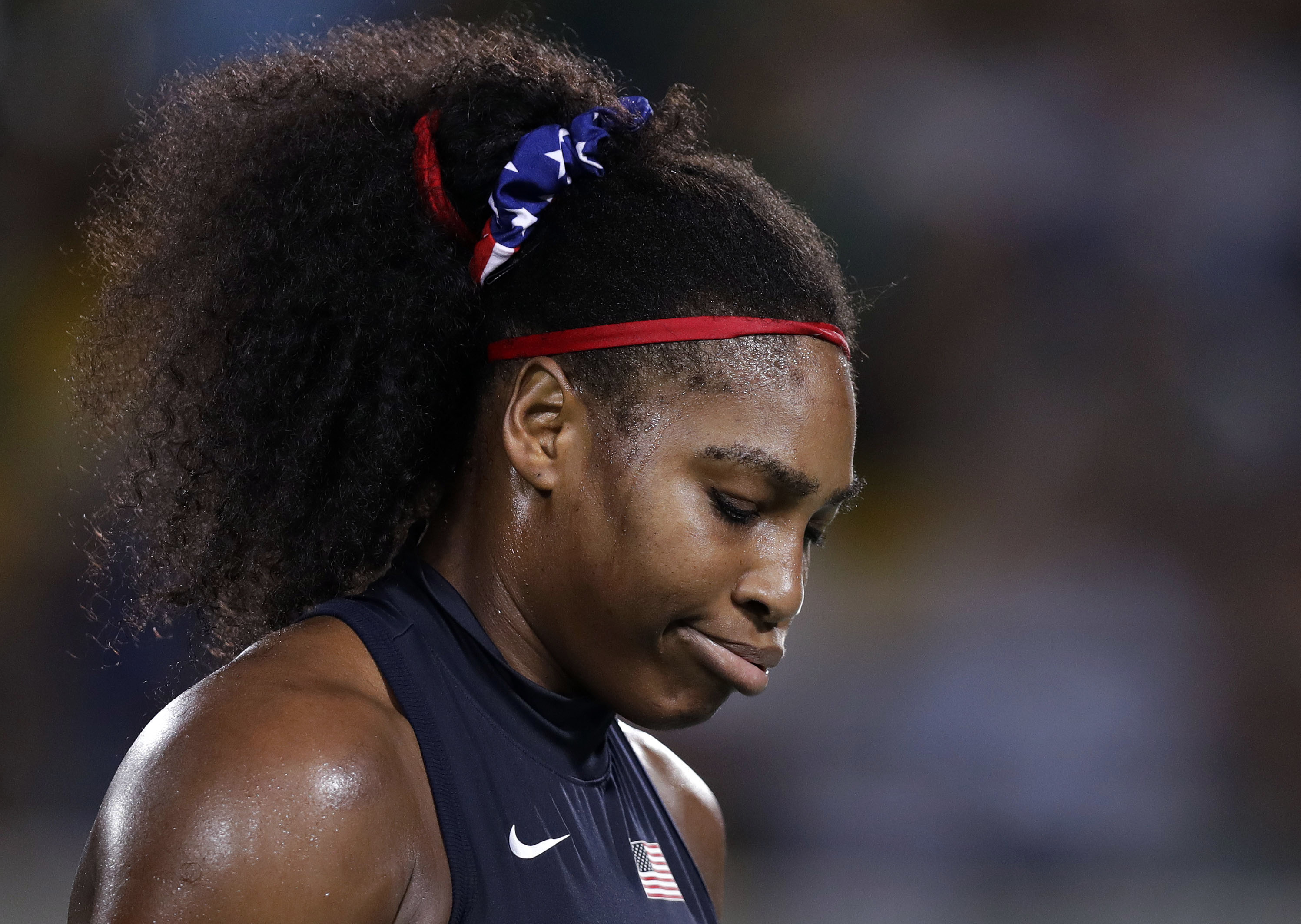 Serena Williams, of the United States, exhales during her loss to Elina Svitolina, of Ukraine, at the 2016 Summer Olympics in Rio de Janeiro, Brazil, Tuesday, Aug. 9, 2016. (AP Photo/Charles Krupa)