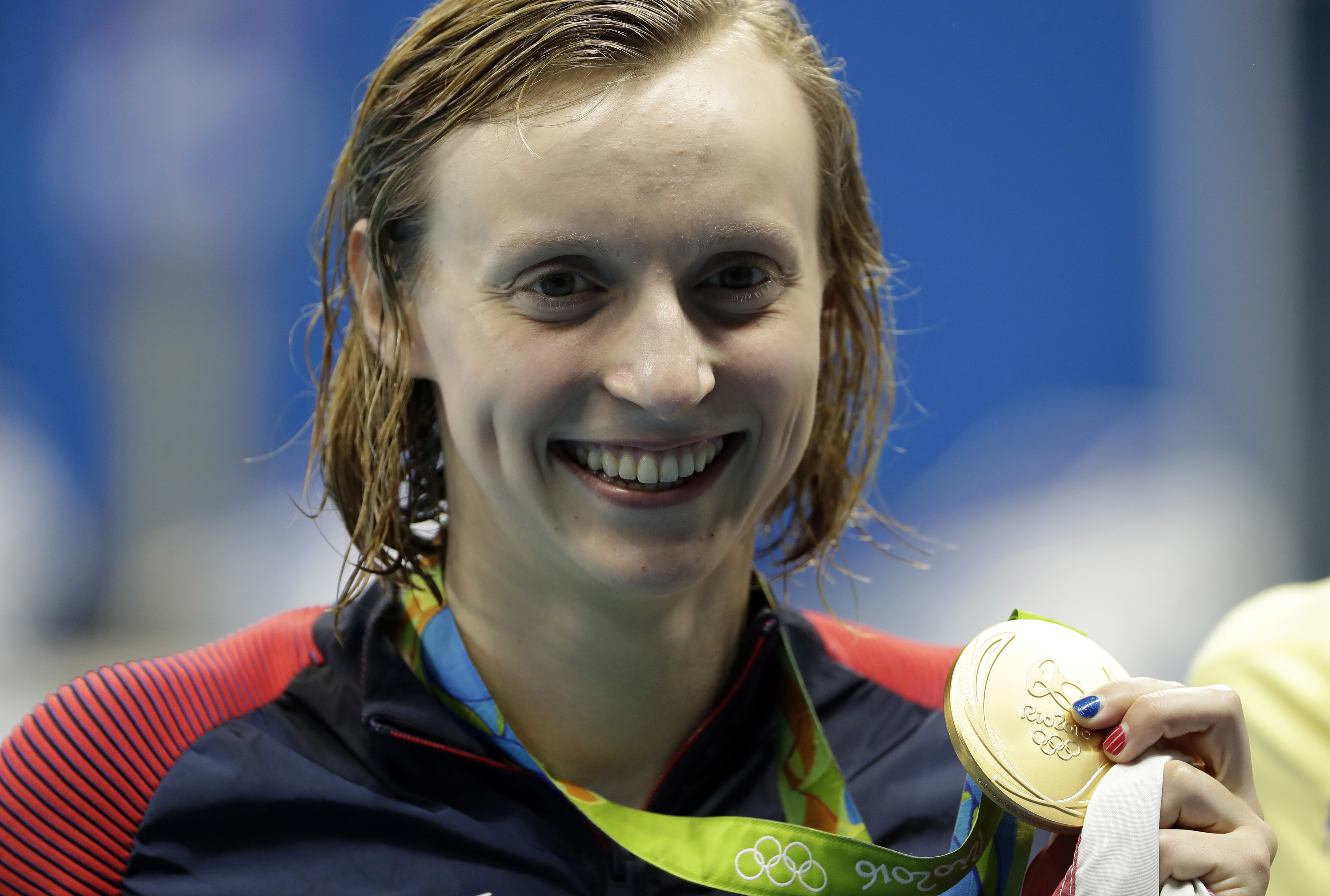United States' Katie Ledecky holds the gold medal after the women's 200-meter freestyle during the swimming competitions at the 2016 Summer Olympics, Tuesday, Aug. 9, 2016, in Rio de Janeiro, Brazil. (AP Photo/Matt Slocum)