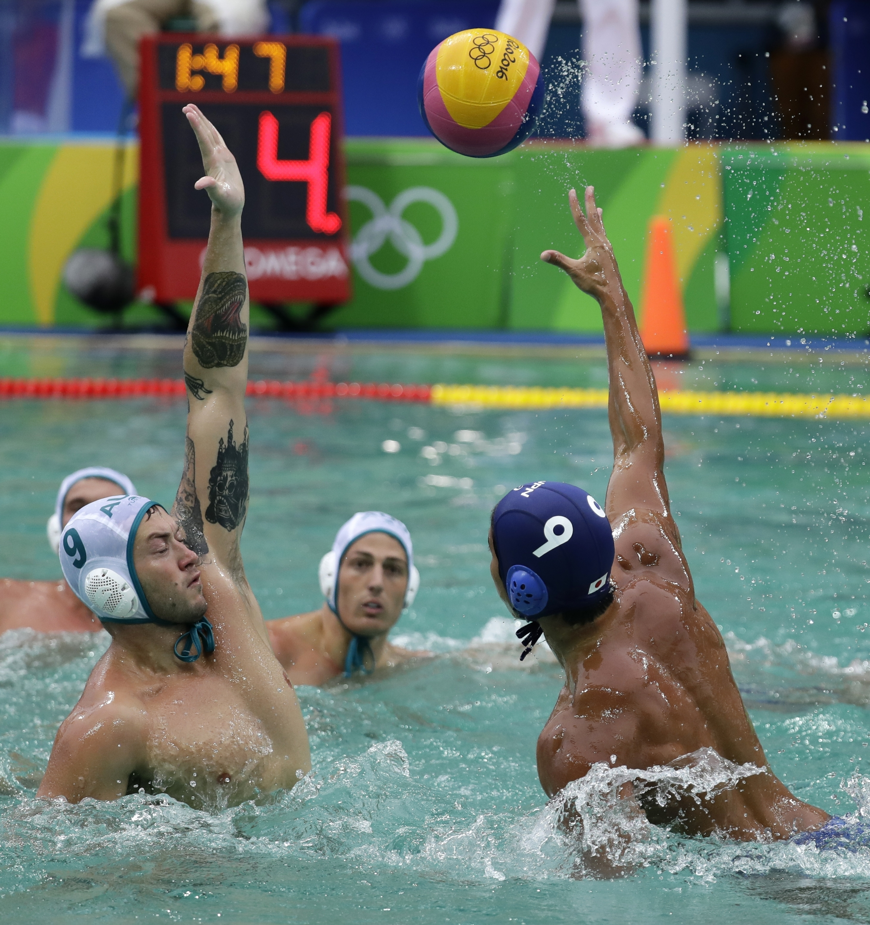 Japan's Koji Take, right, takes a shot as Australia's Joel Swift defends during their men's water polo preliminary round match at the 2016 Summer Olympics in Rio de Janeiro, Brazil, Wednesday, Aug. 10, 2016. (AP Photo/Sergei Grits)
