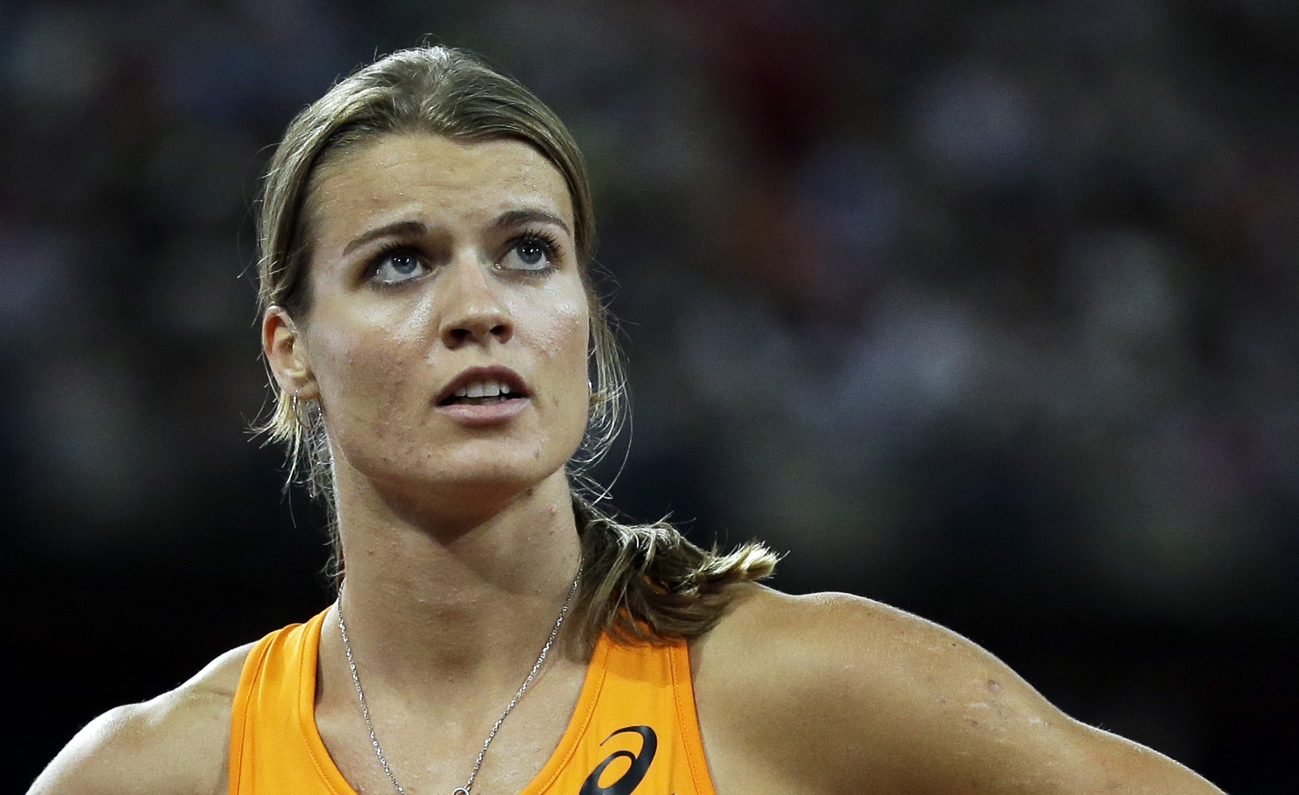 FILE - In this Aug. 27, 2015 file photo, Netherlands' Dafne Schippers looks at the results from her women's 200-meter semifinal at the World Athletics Championships at the Bird's Nest stadium in Beijing, China. Schippers will compete in the sprinting even