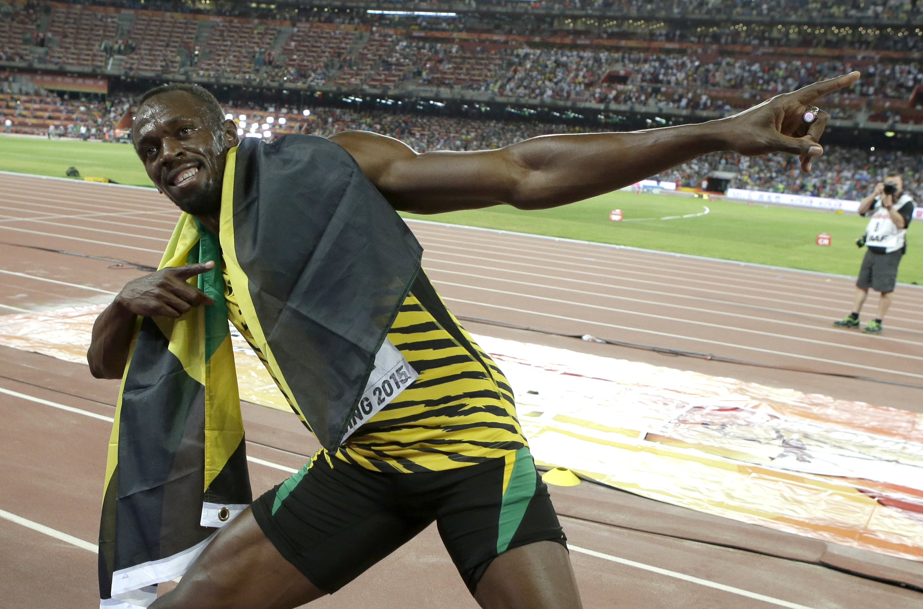 FILE - In this Aug. 23, 2015, file photo, Jamaica's Usain Bolt celebrates after winning the gold medal in the men's 100-meter ahead of United States' at the World Athletics Championships at the Bird's Nest stadium in Beijing. Even though David Rudisha, th