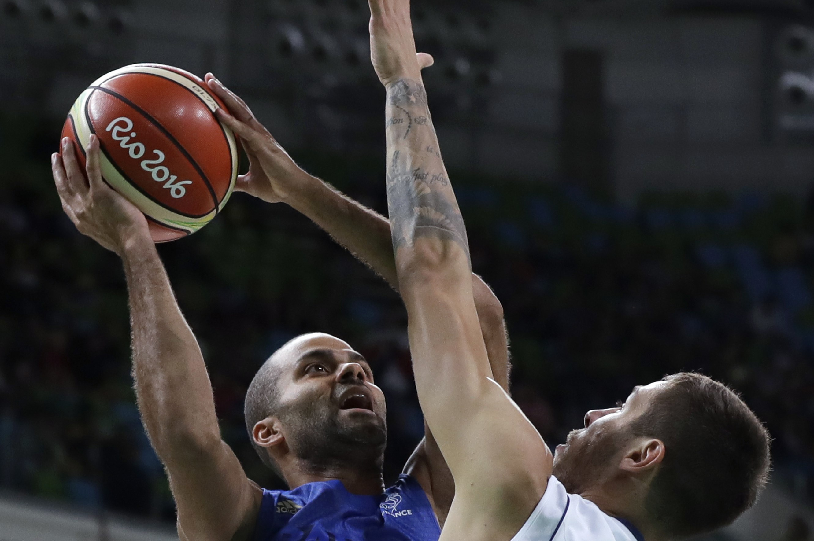 France's Tony Parker (9) shoots over Serbia's Stefan Jovic (24) during a basketball game at the 2016 Summer Olympics in Rio de Janeiro, Brazil, Wednesday, Aug. 10, 2016. (AP Photo/Charlie Neibergall)