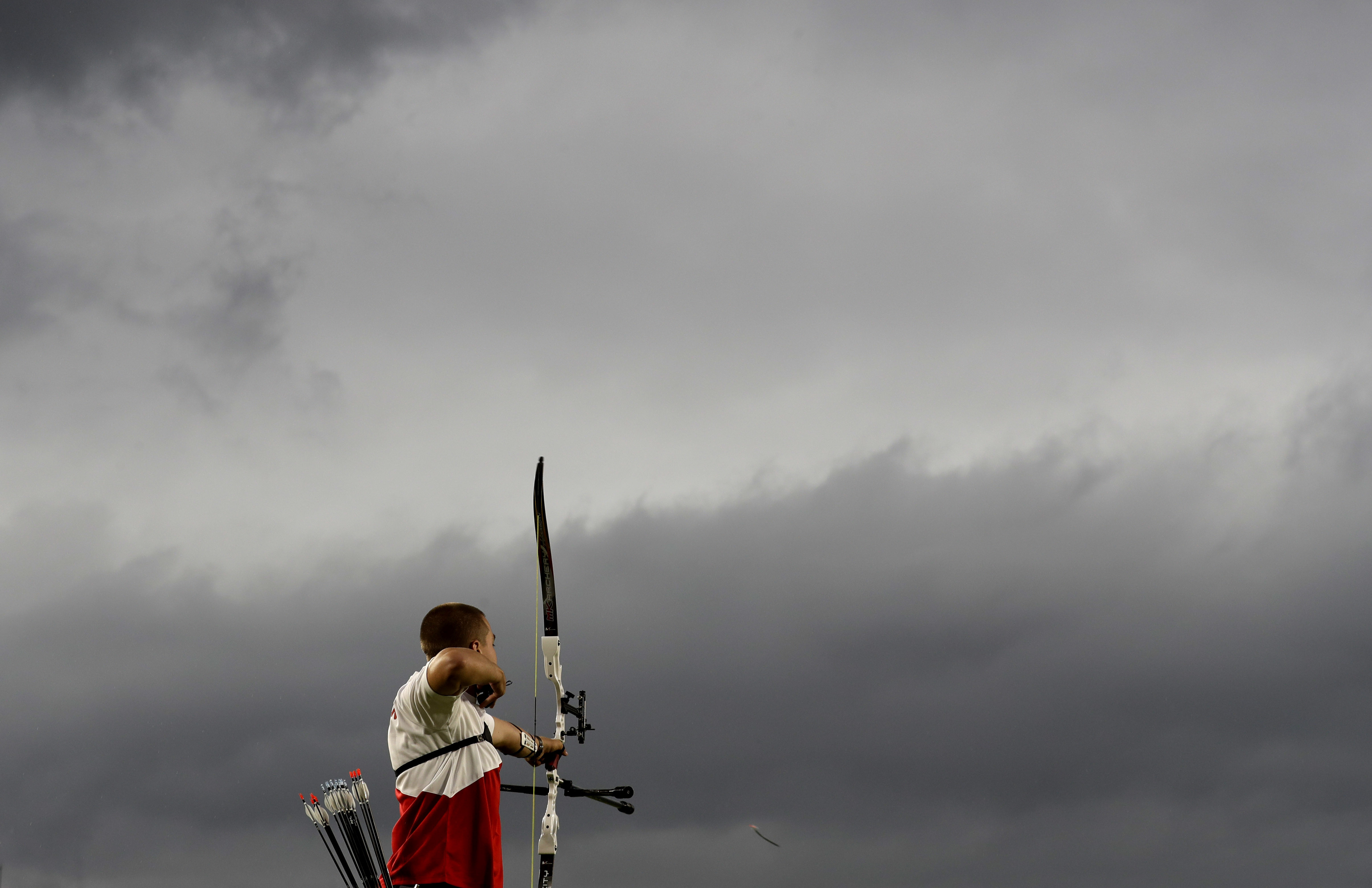 Belgium's Robin Ramaekers releases his arrow during an elimination round of the individual archery competition at the Sambadrome venue during the 2016 Summer Olympics in Rio de Janeiro, Brazil, Wednesday, Aug. 10, 2016. (AP Photo/Alessandra Tarantino)