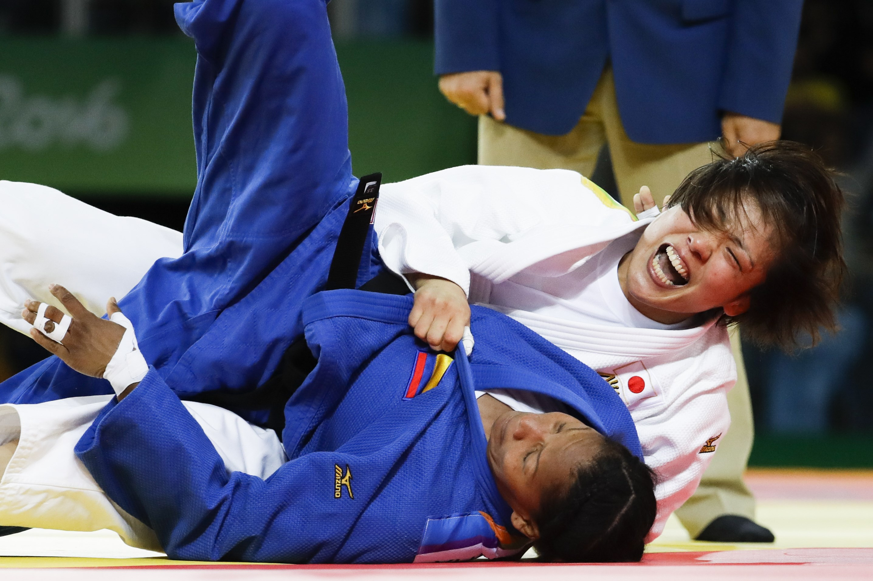 Japan's Haruka Tachimoto, white, competes against, Colombia's Yadinys Amaris for the gold medal during the women's 70-kg judo competition at at the 2016 Summer Olympics in Rio de Janeiro, Brazil, Wednesday, Aug. 10, 2016. (AP Photo/Markus Schreiber)