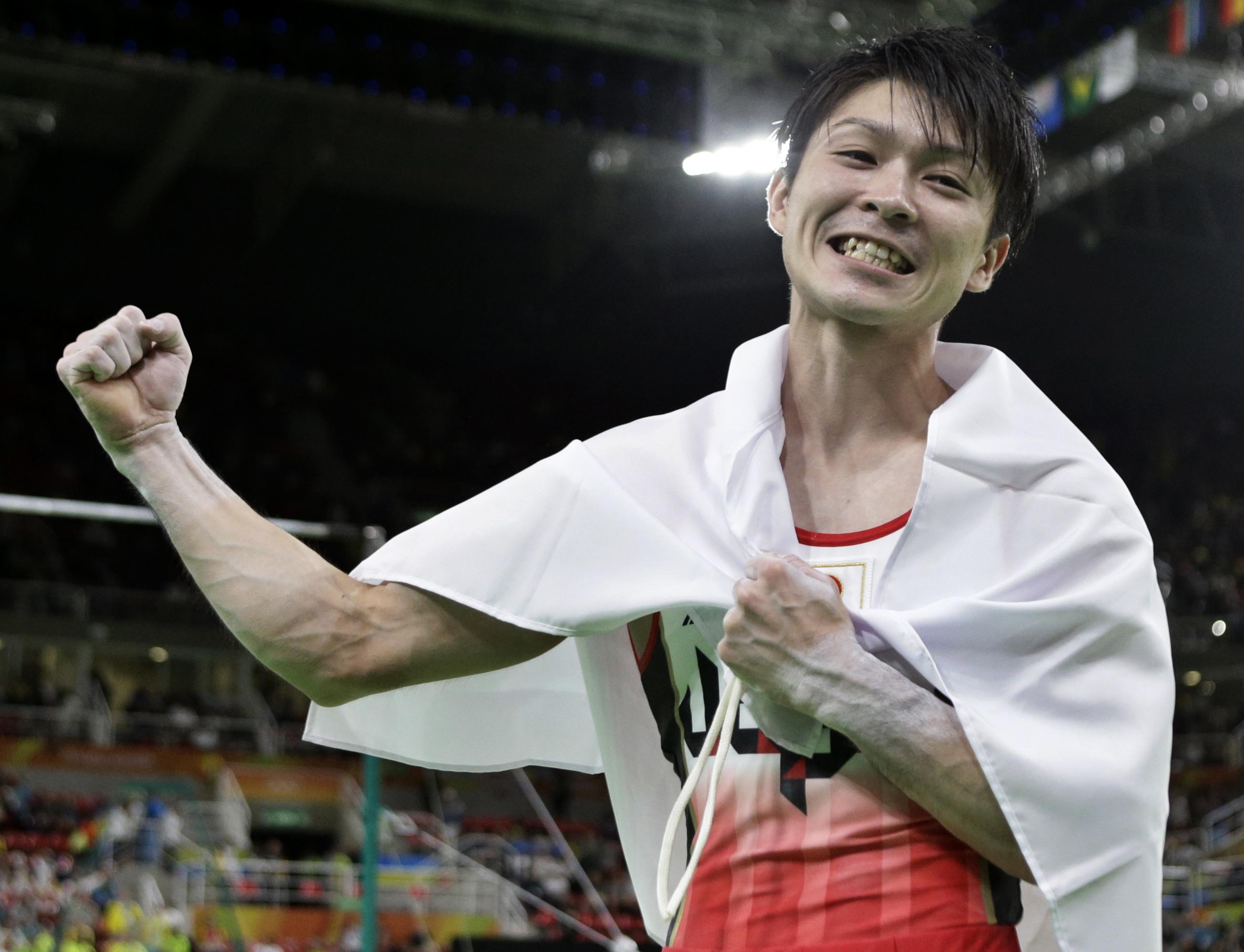 Japan's Kohei Uchimura celebrates his gold during the artistic gymnastics men's individual all-around final at the 2016 Summer Olympics in Rio de Janeiro, Brazil, Wednesday, Aug. 10, 2016. (AP Photo/Rebecca Blackwell)