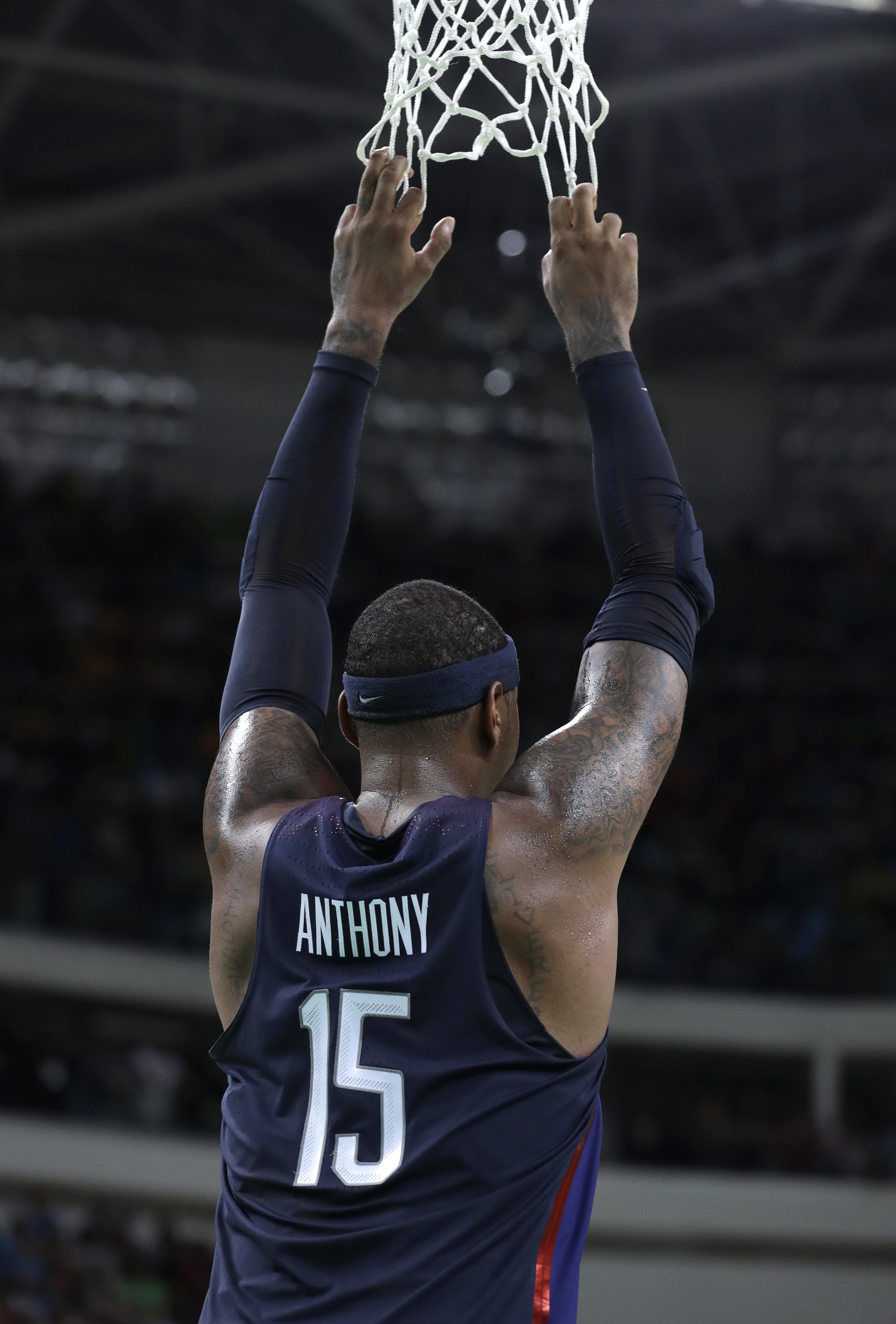United States' Carmelo Anthony (15) watches the final seconds of a basketball game against Australia at the 2016 Summer Olympics in Rio de Janeiro, Brazil, Wednesday, Aug. 10, 2016. (AP Photo/Charlie Neibergall)