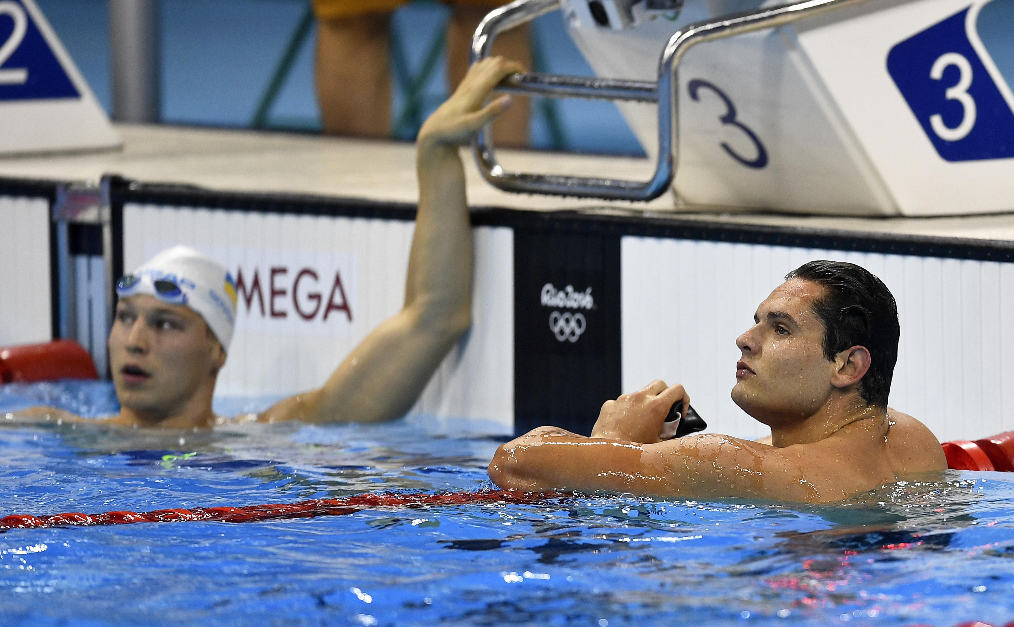 France's Florent Manaudou, right, and Ukraine's Andrii Govorov check their times during a men's 50-meter freestyle heat during the swimming competitions at the 2016 Summer Olympics, Thursday, Aug. 11, 2016, in Rio de Janeiro, Brazil. (AP Photo/Martin Meis