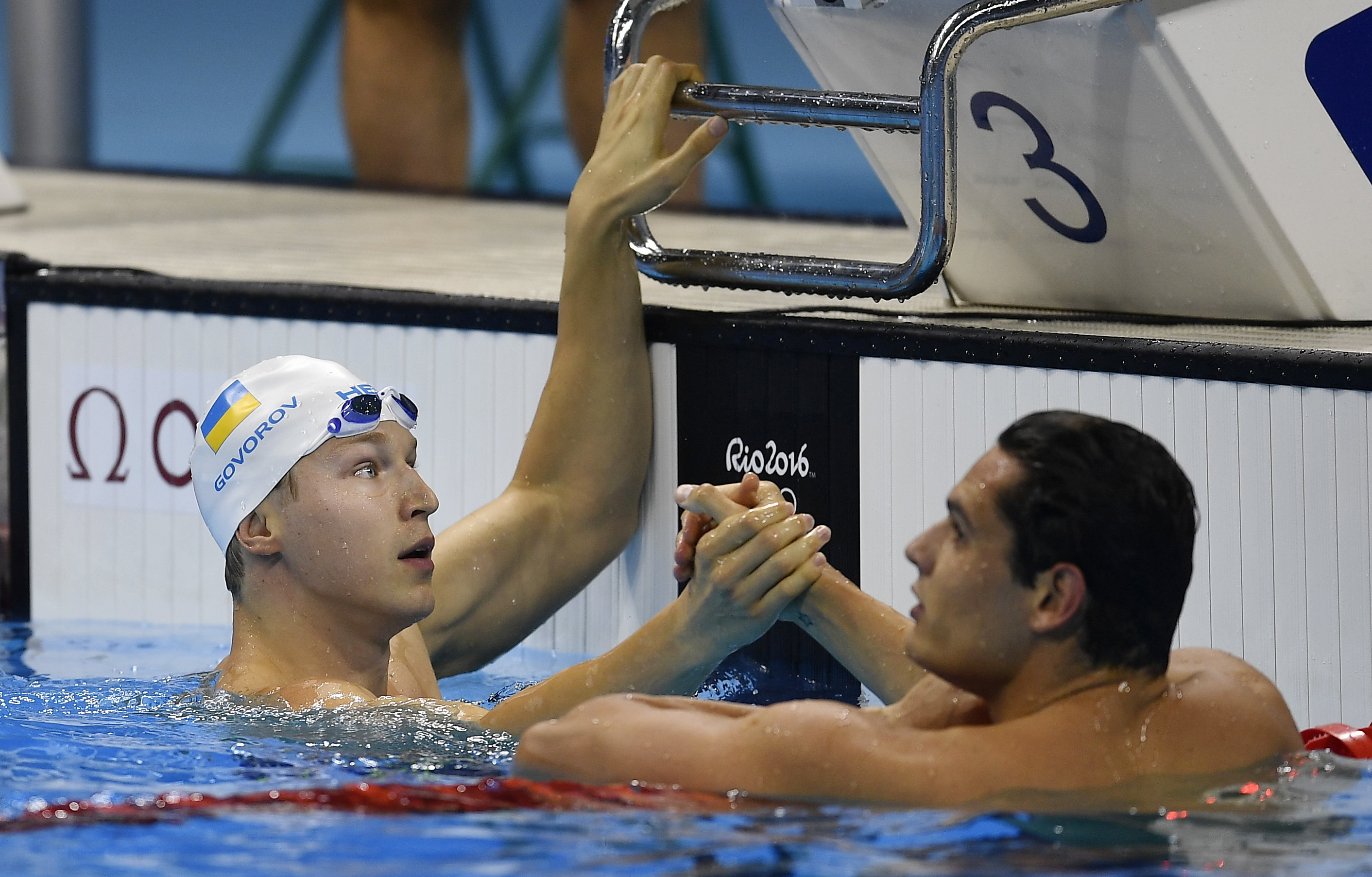 Ukraine's Andrii Govorov, left, and France's Florent Manaudou celebrate after a men's 50-meter freestyle heat during the swimming competitions at the 2016 Summer Olympics, Thursday, Aug. 11, 2016, in Rio de Janeiro, Brazil. (AP Photo/Martin Meissner)