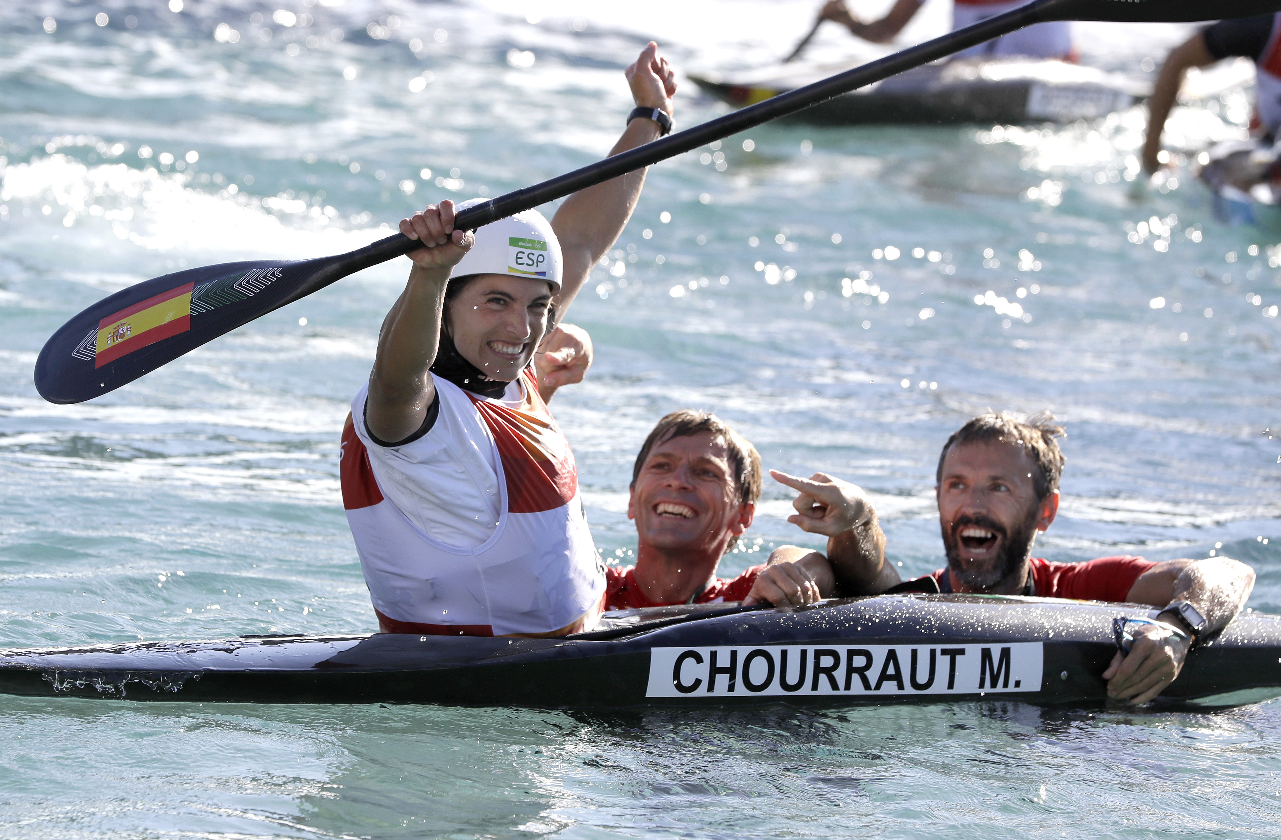 Gold medal winner Maialen Chourraut of Spain celebrates with team members after she finishes the kayak K1 women's final of the canoe slalom at the 2016 Summer Olympics in Rio de Janeiro, Brazil, Thursday, Aug. 11, 2016. (AP Photo/Kirsty Wigglesworth)