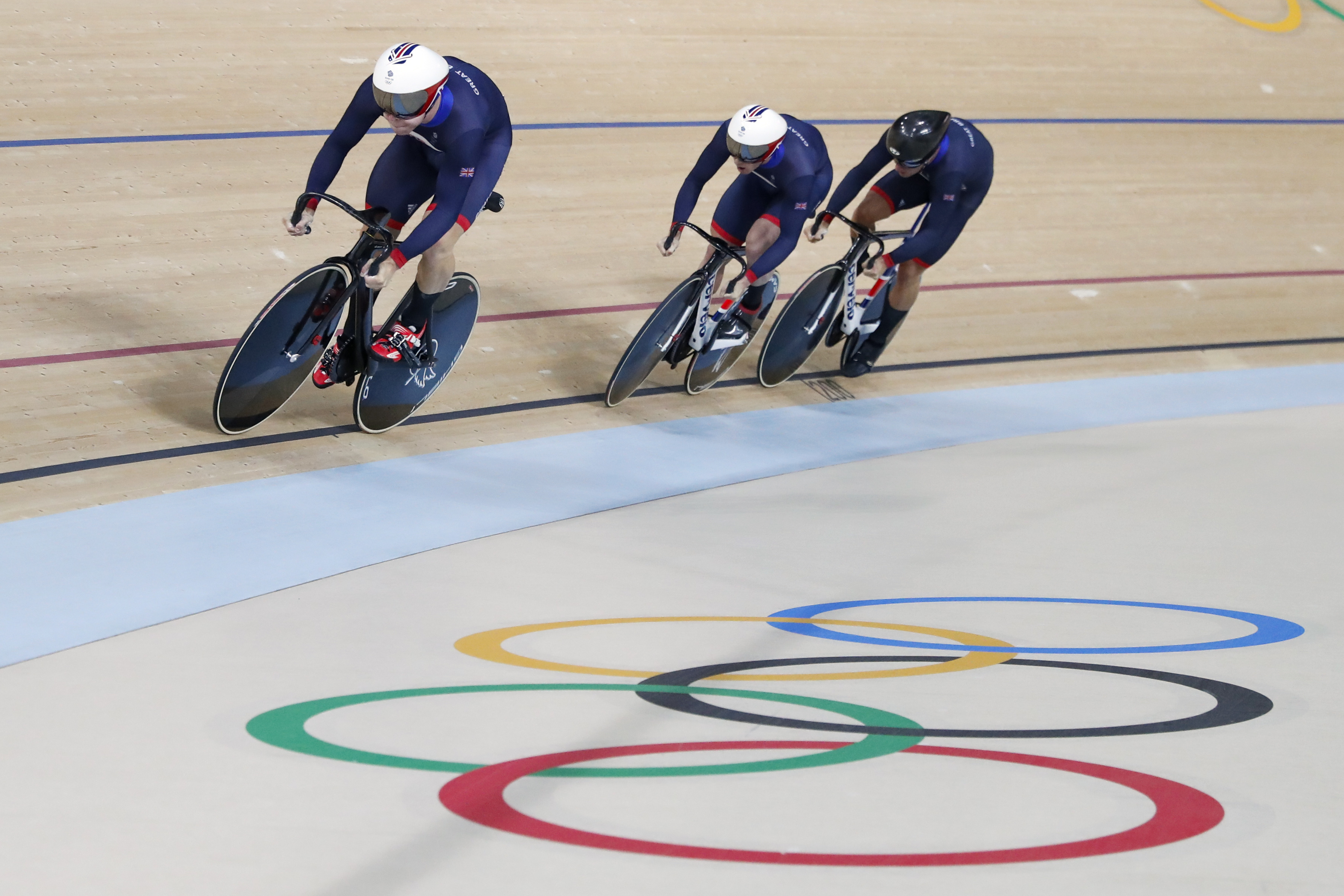 Great Britain's team competes in the men's team sprint qualifying at the Rio Olympic Velodrome during the 2016 Summer Olympics in Rio de Janeiro, Brazil, Thursday, Aug. 11, 2016. (AP Photo/Patrick Semansky)