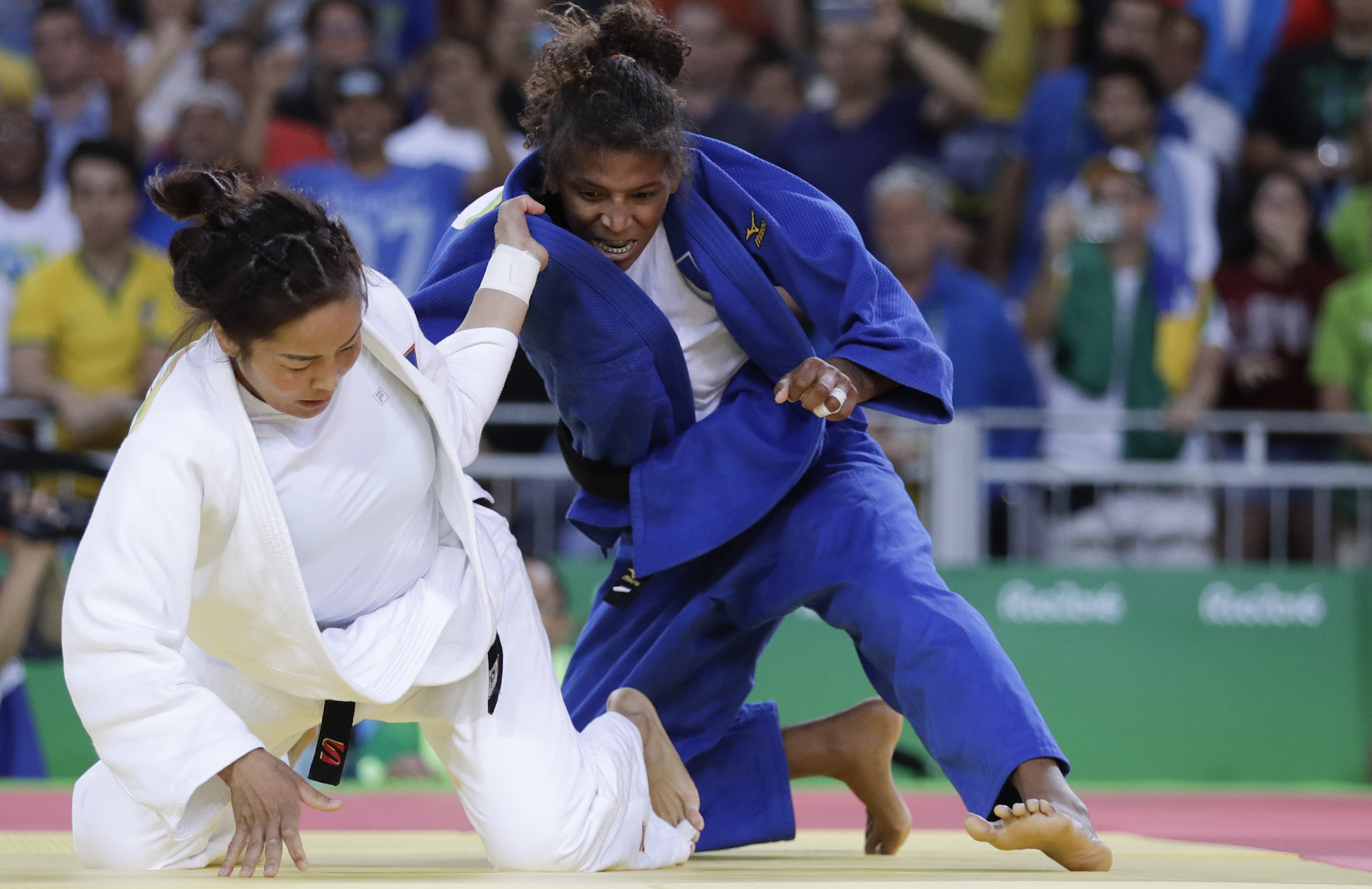 FILE - In this Aug. 8, 2016, file photo, Brazil's Rafaela Silva, right, competes with Mongolia's Sumiya Dorjsuren for the gold medal of the women's 57-kg judo competition at the 2016 Summer Olympics in Rio de Janeiro, Brazil. Brazil is trying to take adva