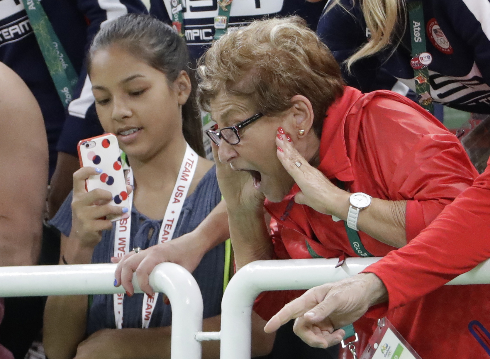 Martha Karolyi, U.S. gymnastics team coordinator, celebrates from the stands after U.S. gymnasts Simone Biles and Aly Raisman won gold and silver respectively during the artistic gymnastics women's individual all-around final at the 2016 Summer Olympics i
