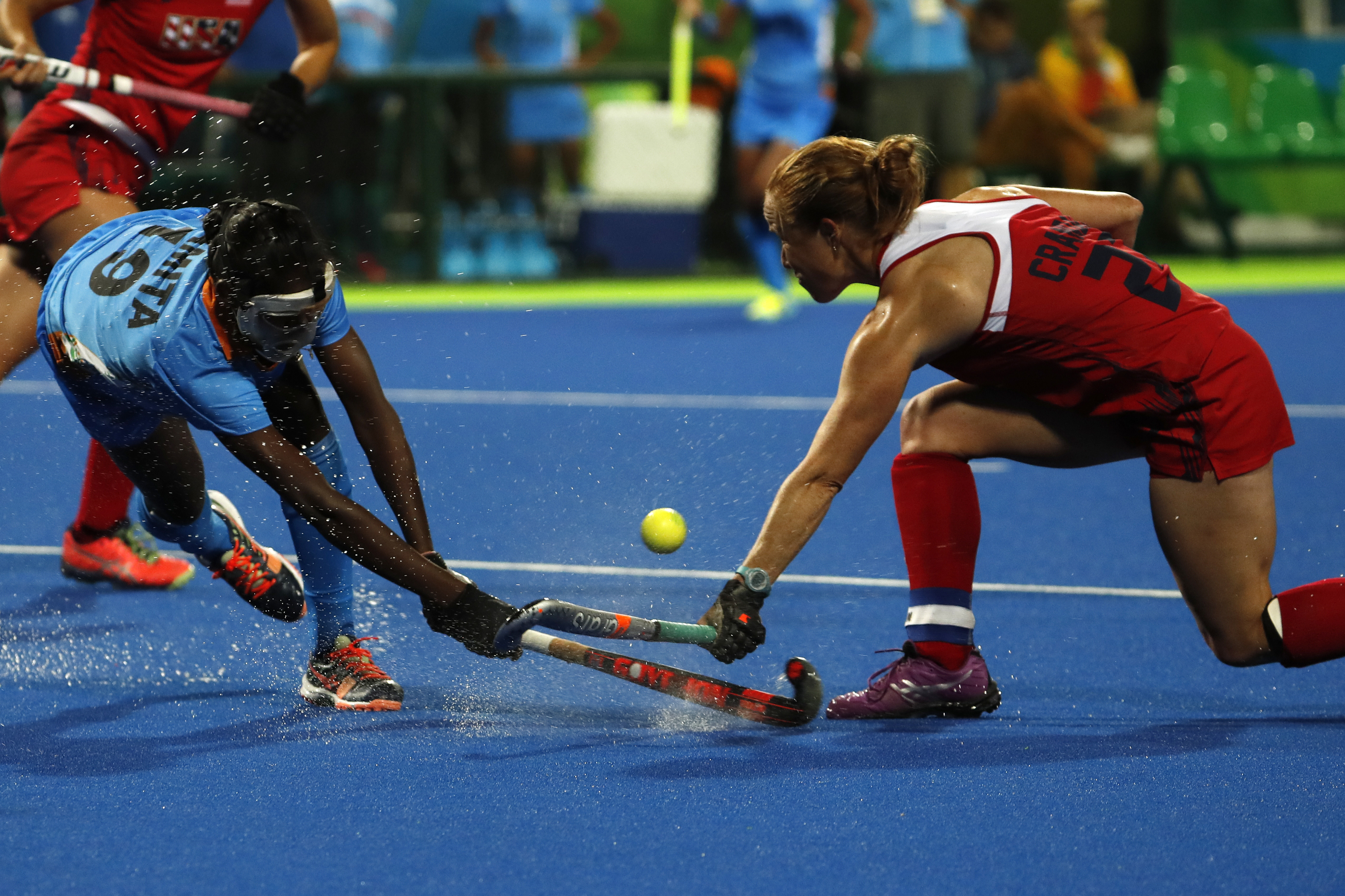 United States' Lauren Crandall, right, fights for the ball with India's Namita Toppo during a women's field hockey match at the 2016 Summer Olympics in Rio de Janeiro, Brazil, Thursday, Aug. 11, 2016. (AP Photo/Dario Lopez-Mills)