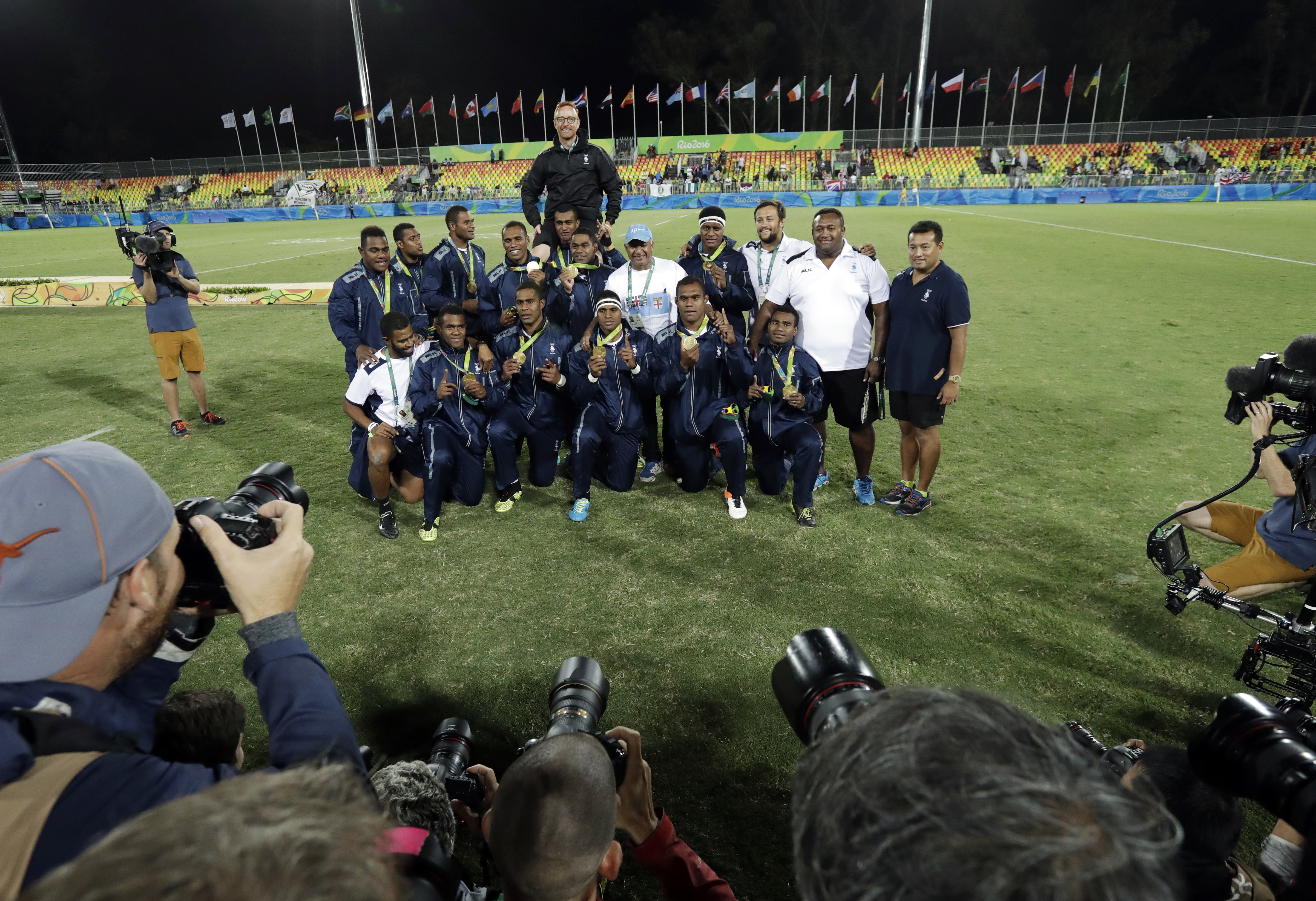 Fiji's rugby team poses after winning their country's first Olympic medal after taking gold by defeating Britain in mens rugby sevens at the 2016 Summer Olympics in Rio de Janeiro, Brazil, Thursday, Aug. 11, 2016. (AP Photo/Robert F. Bukaty)