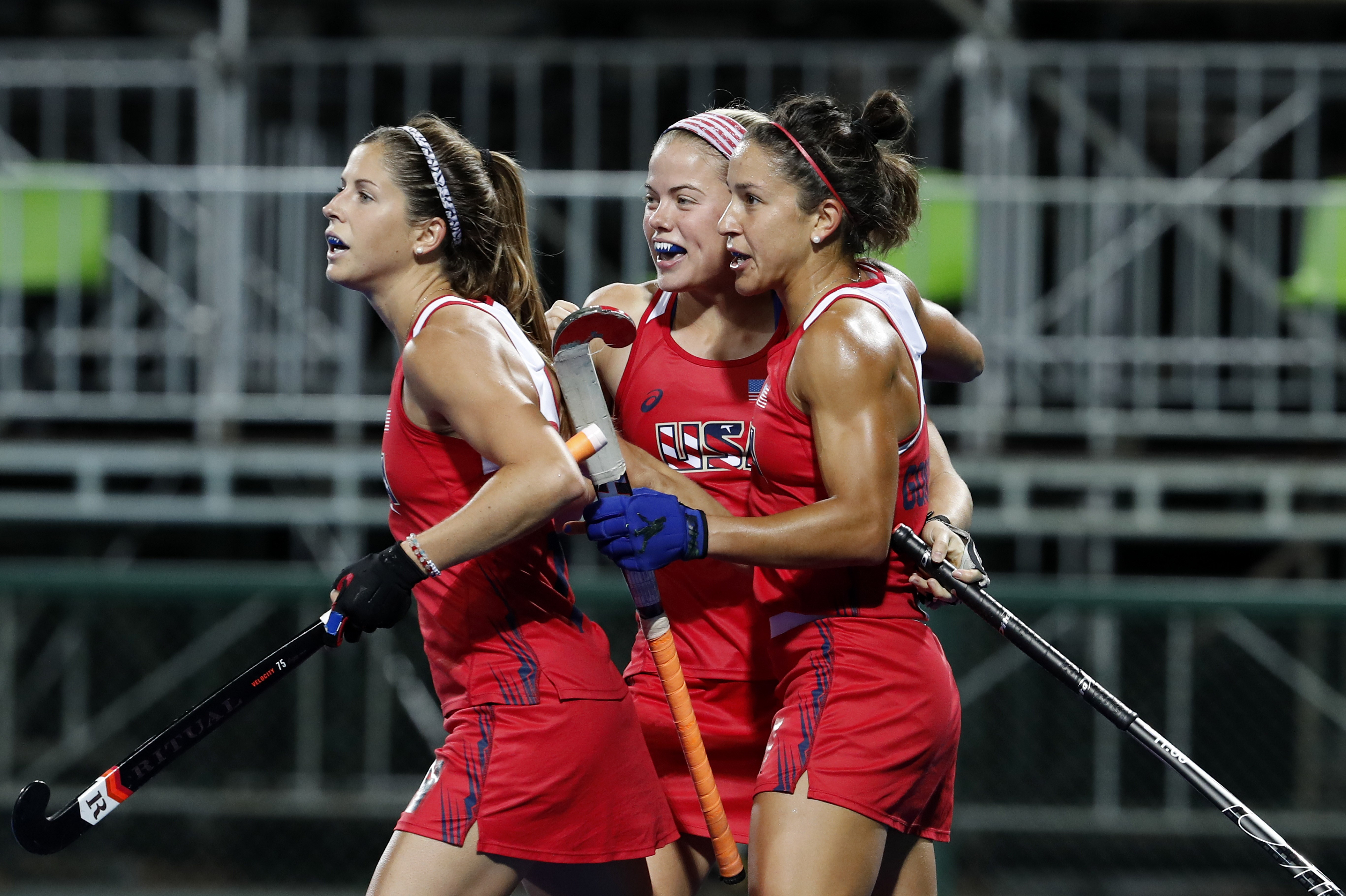 Players of United States celebrate after scoring third goal against India during a women's field hockey match at the 2016 Summer Olympics in Rio de Janeiro, Brazil, Thursday, Aug. 11, 2016. (AP Photo/Dario Lopez-Mills)