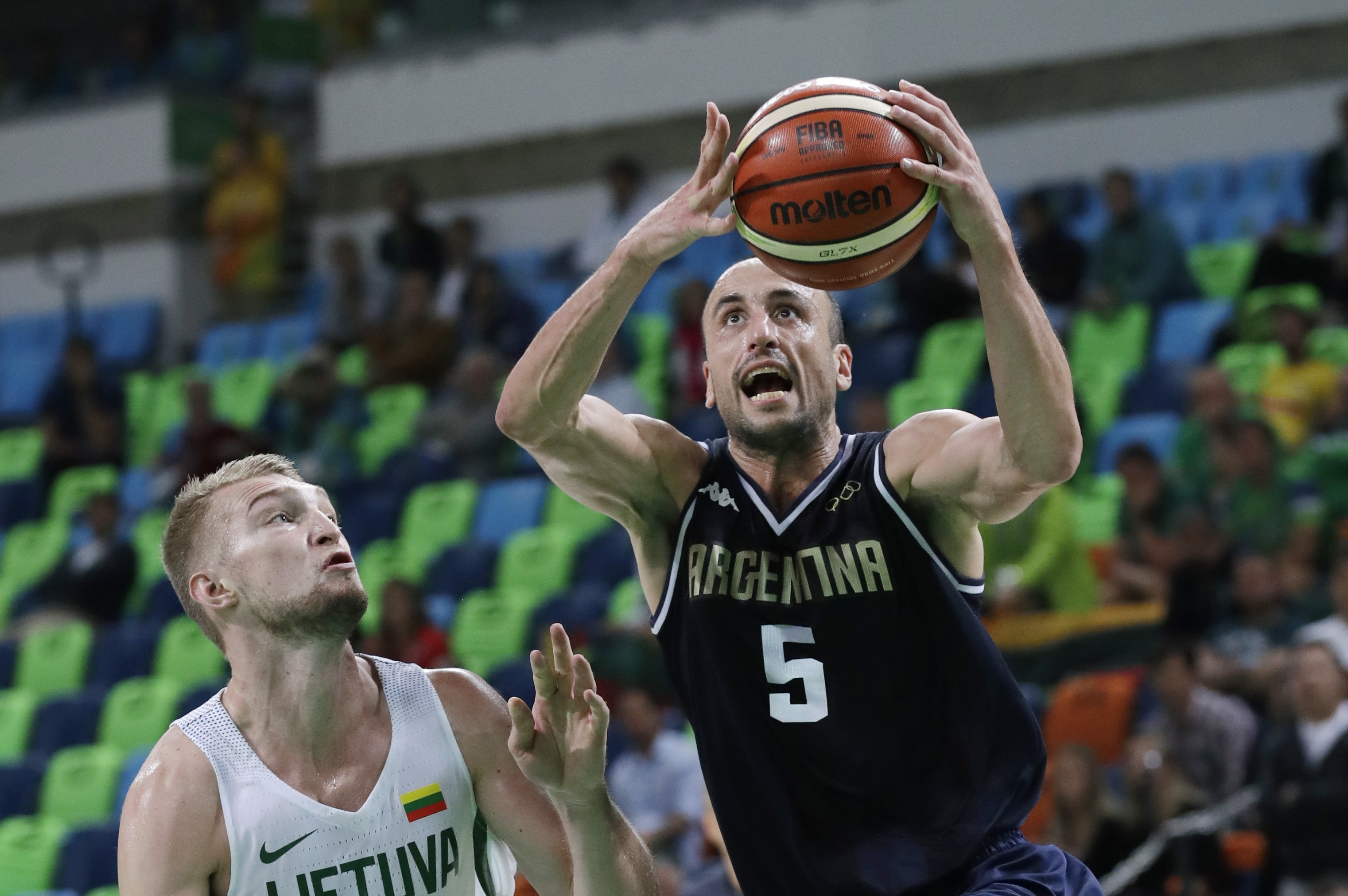 Argentina's Manu Ginobili (5) drives to the basket past Lithuania's Domantas Sabonis (11) during a basketball game at the 2016 Summer Olympics in Rio de Janeiro, Brazil, Thursday, Aug. 11, 2016. (AP Photo/Charlie Neibergall)