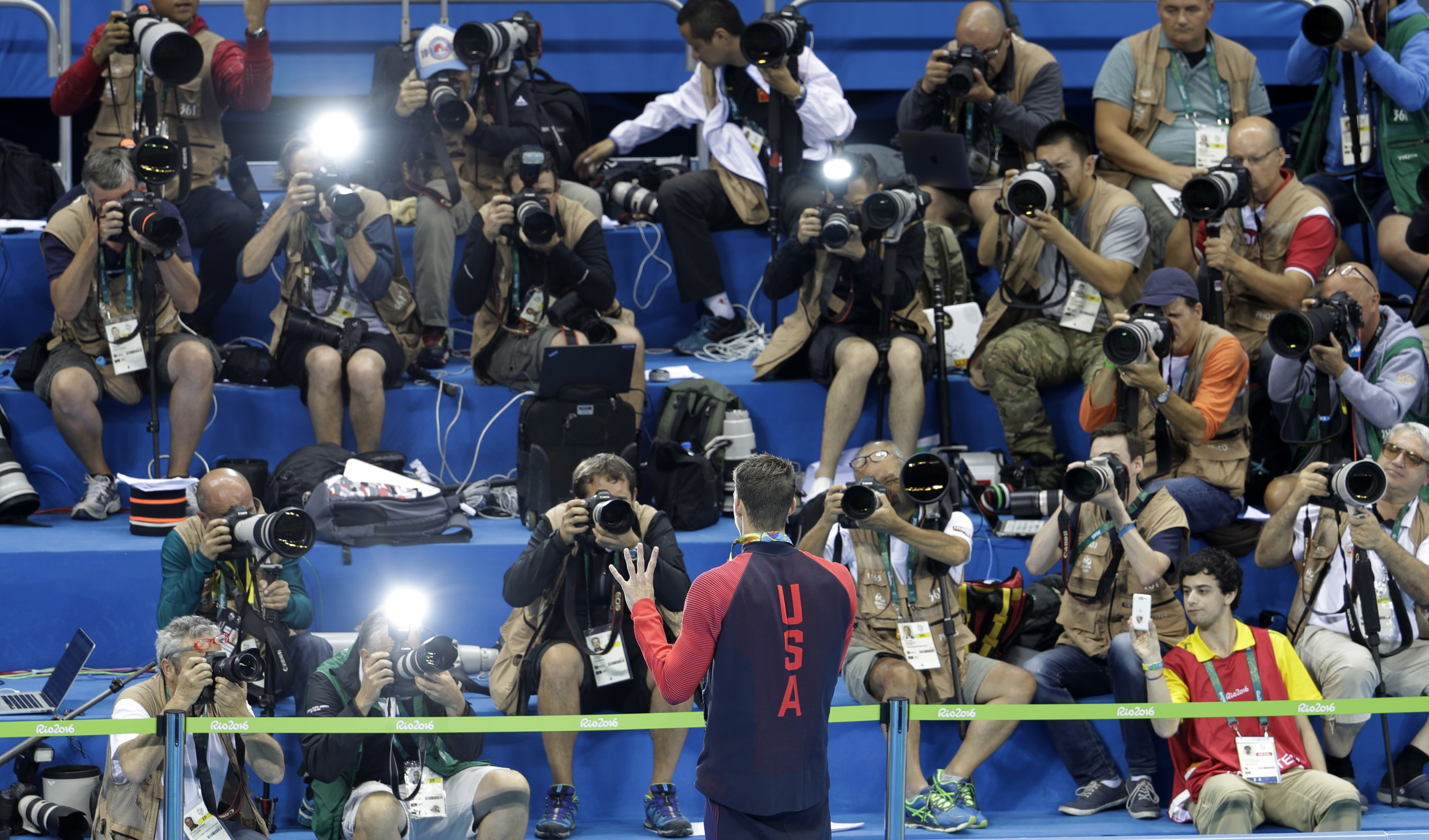 United States' Michael Phelps shows his gold medal for the men's 200-meter individual medley to the media during the swimming competitions at the 2016 Summer Olympics, Thursday, Aug. 11, 2016, in Rio de Janeiro, Brazil. (AP Photo/Natacha Pisarenko)